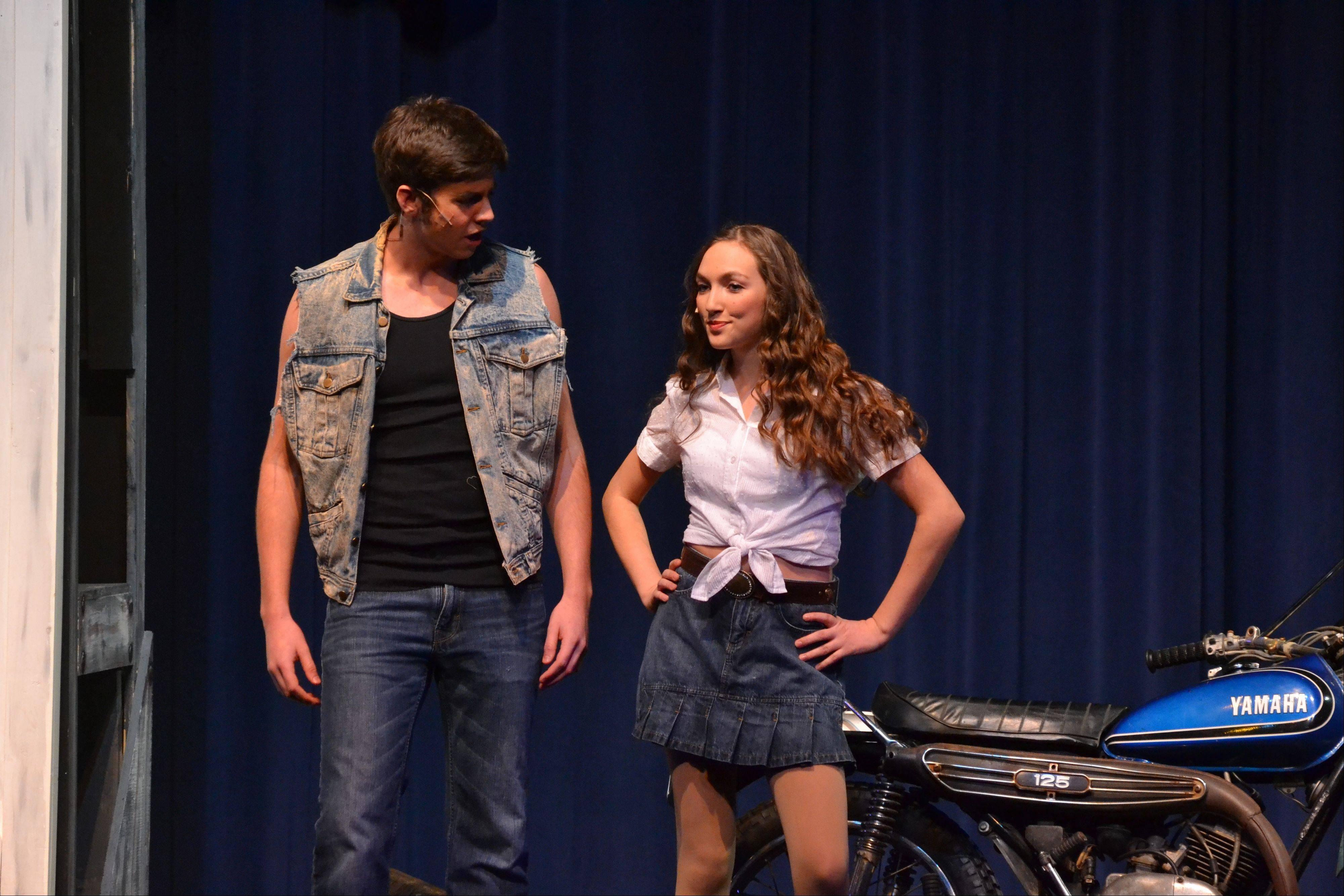 "Chuck, played by Jerry Cavanagh of Arlington Heights, and Ariel, played by Maria Werba of Arlington Heights, in an early scene from the Saint Viator production of ""Footloose."""