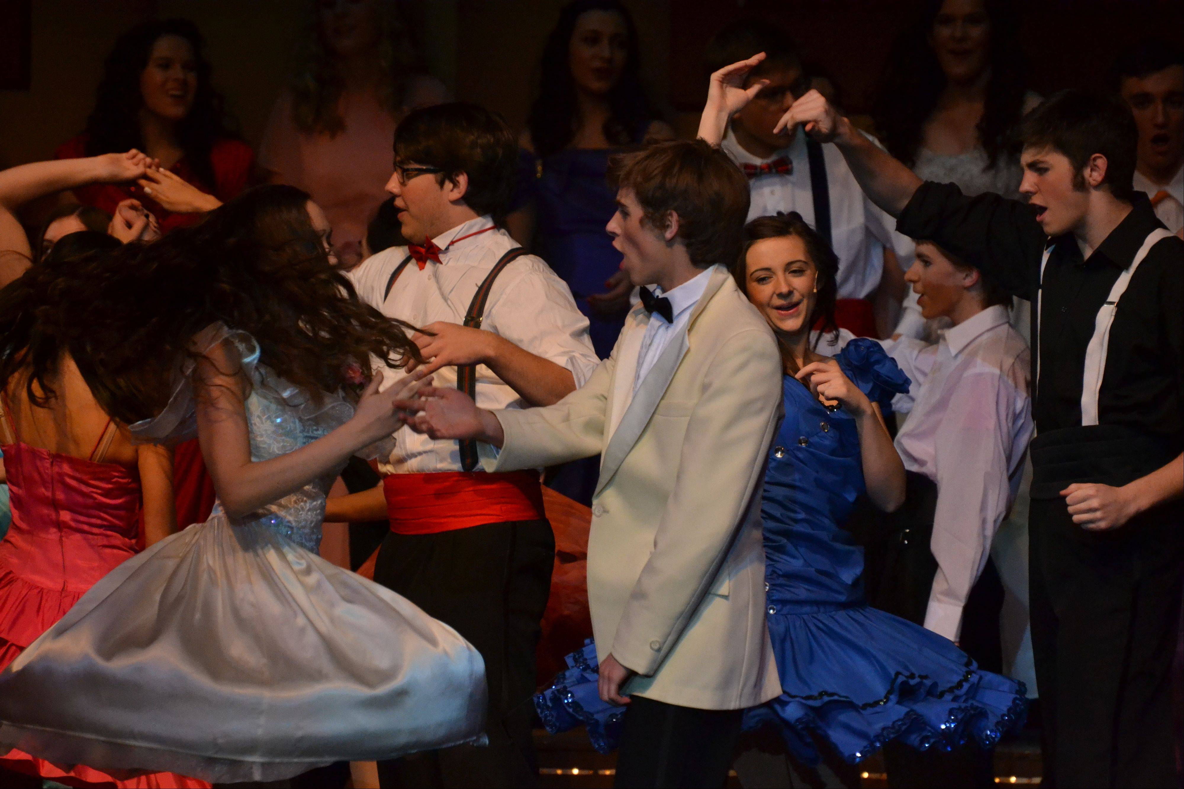"Ariel, played by junior Maria Werba, and Ren, played by junior John McManus, both of Arlington Heights, lead the ensemble in the show's final number of ""Footloose."""
