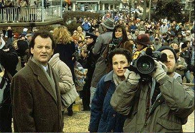 "Bill Murray, Andie MacDowell and Chris Elliot stand on the Woodstock set of the 1993 supernatural comedy ""Groundhog Day."" The script was written by Danny Rubin, who will be in Woodstock this weekend to celebrate the movie."