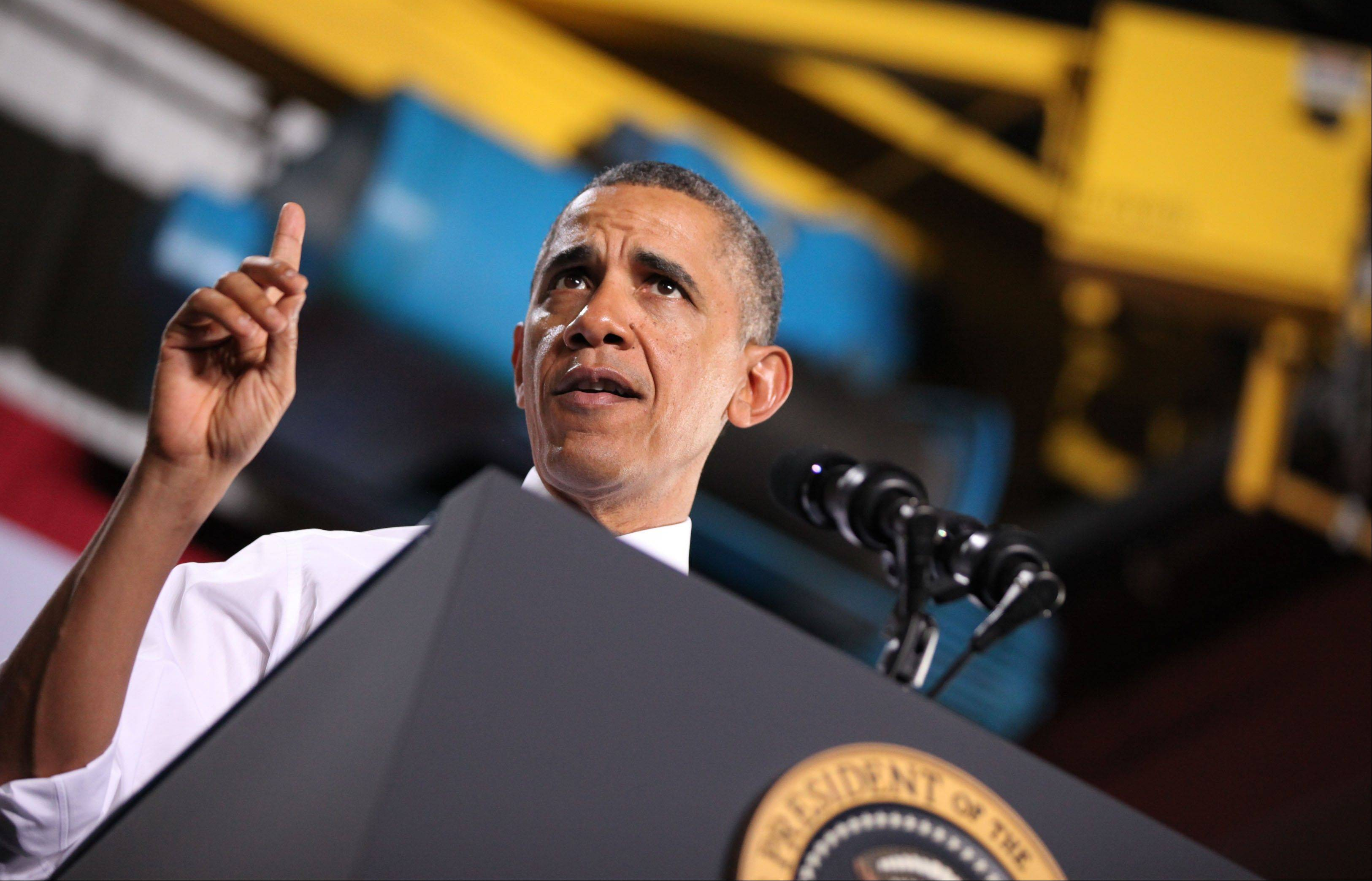 President Barack Obama speaks at General Electric's gas engine facility in Waukesha, Wis., Thursday. The visit is part of a four-state tour the president is making following his State of the Union speech on Tuesday.
