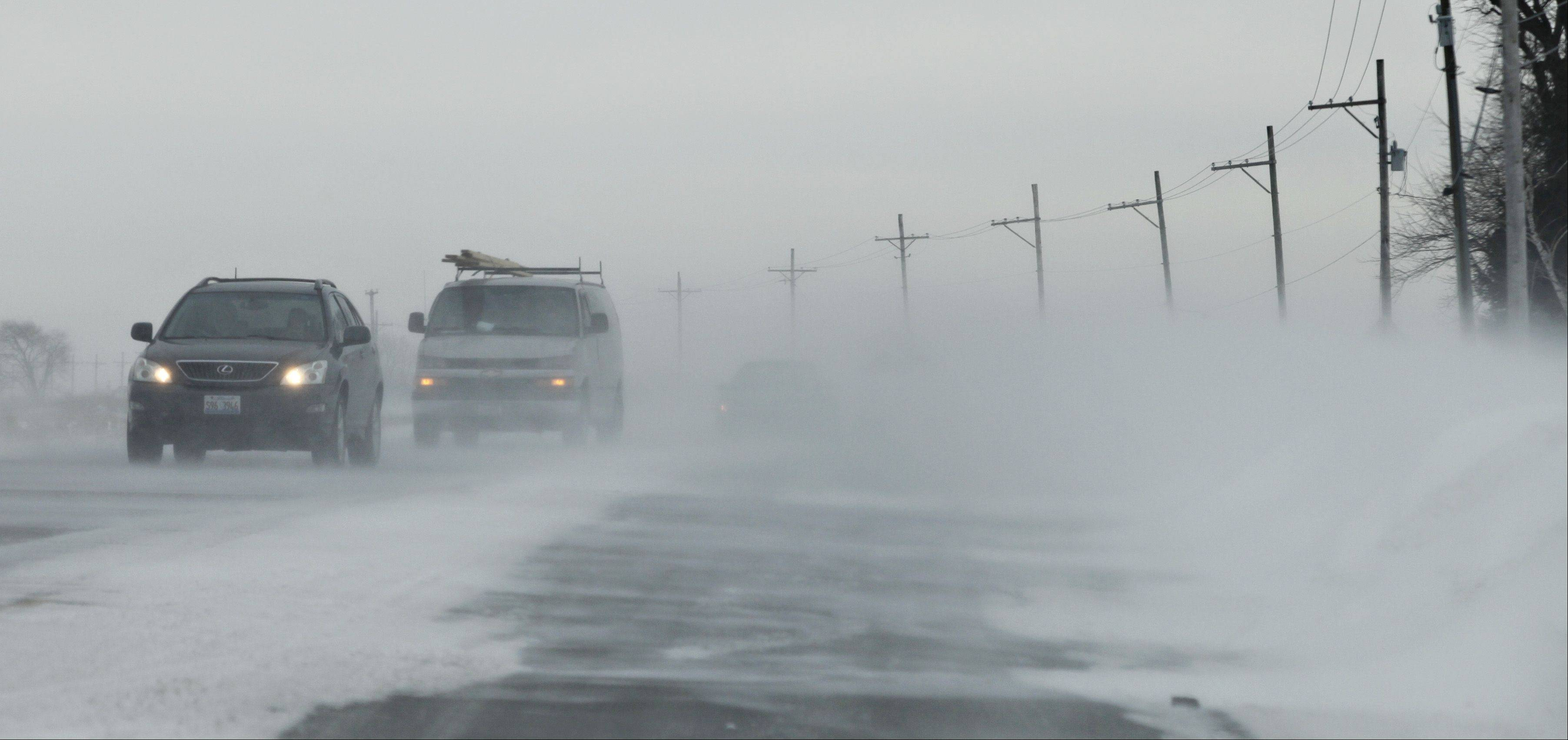 High winds Thursday created near whiteout conditions on rural roads in Kane County, as pictured here on Huntley Road east of Square Barn Road near Gilberts. Several accidents Thursday were also blamed on snow-covered or icy roads.