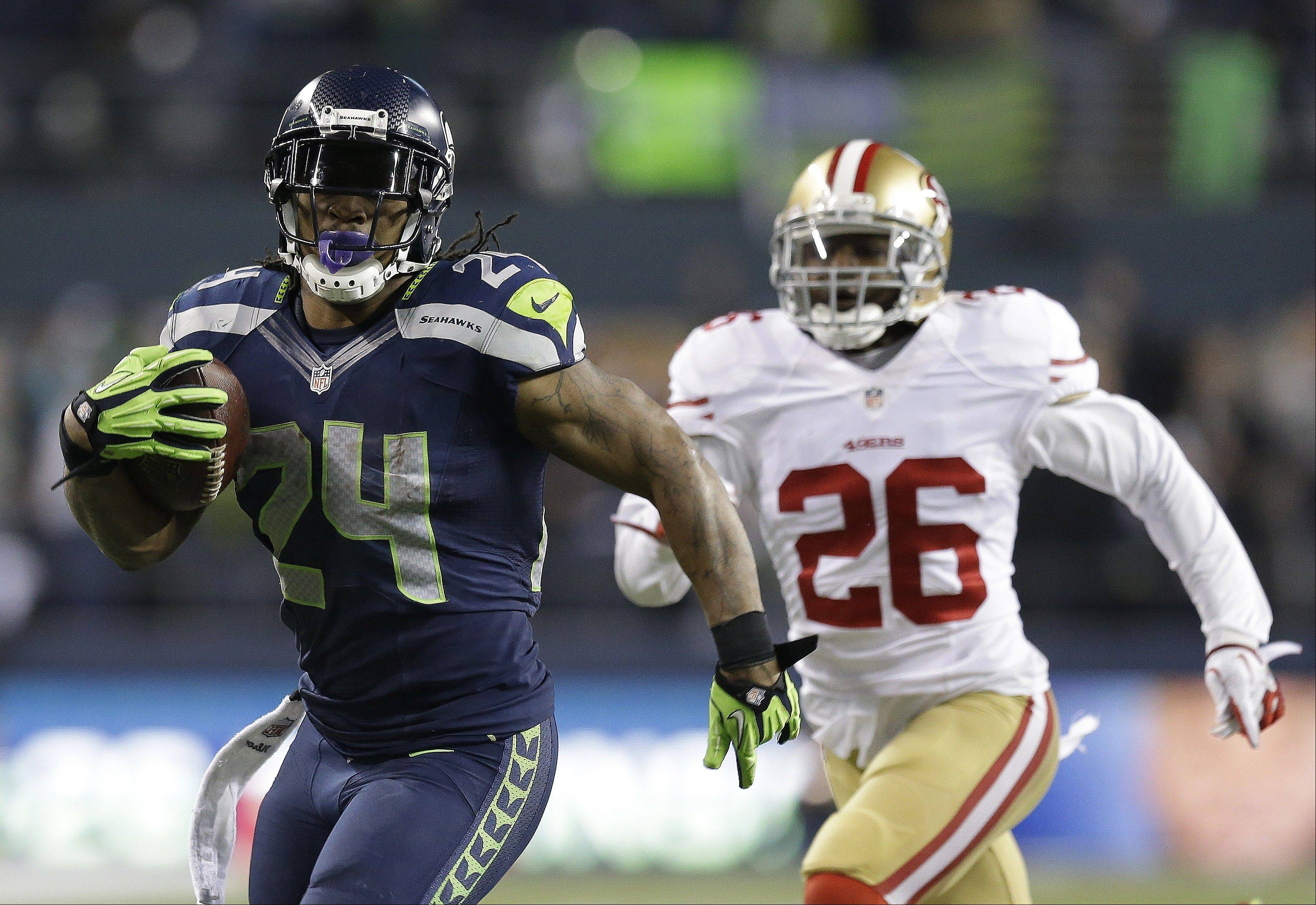 Seattle Seahawks' Marshawn Lynch (24) breaks away from San Francisco 49ers' Tramaine Brock (26) for a touch-down run during the second half of the NFL football NFC Championship game, Sunday, Jan. 19, 2014, in Seattle. (AP Photo/Elaine Thompson)
