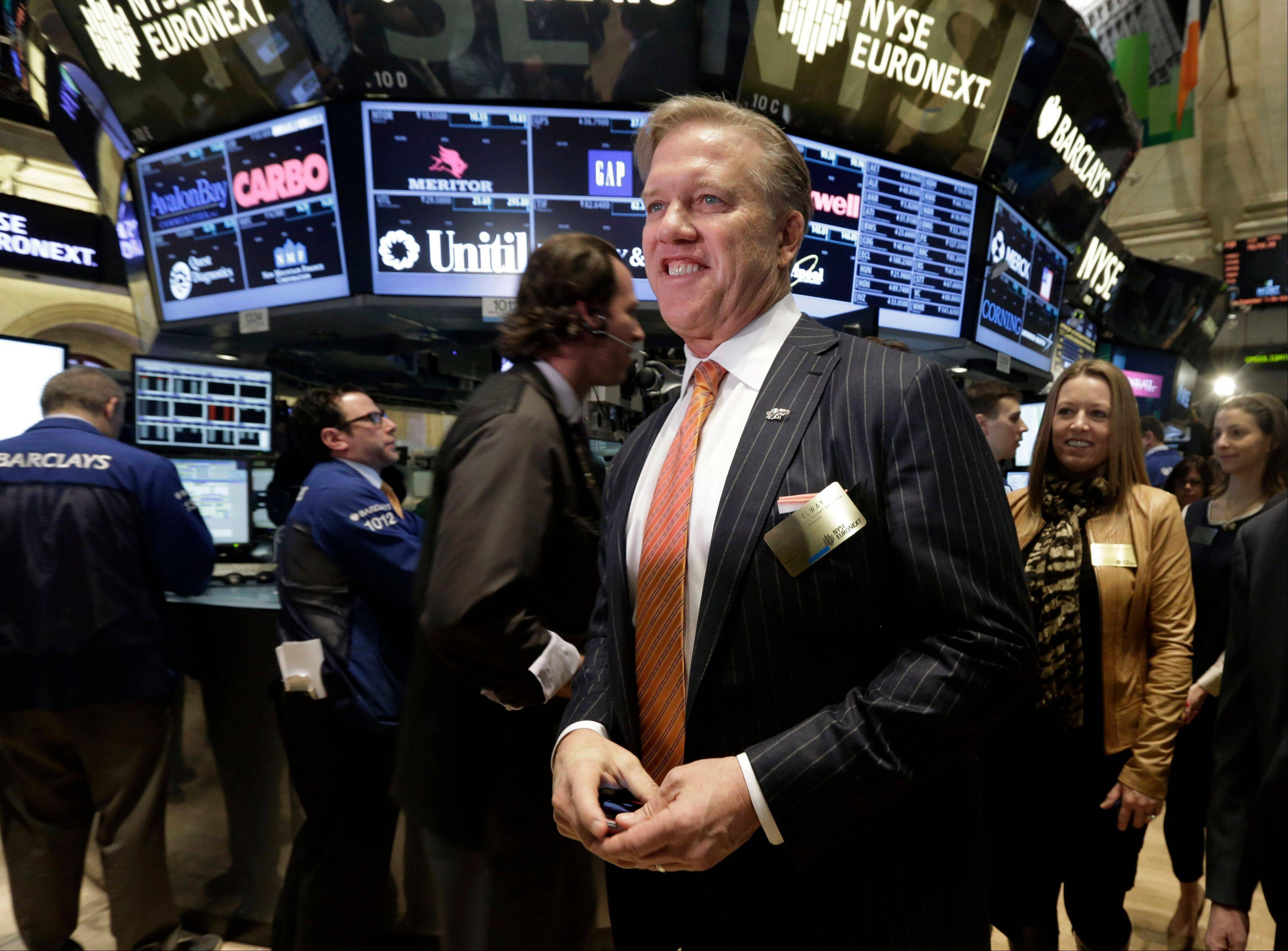 Denver Broncos Executive VP of Football Operations John Elway walks the trading floor before New York Stock Exchange opening bell ceremonies Thursday.