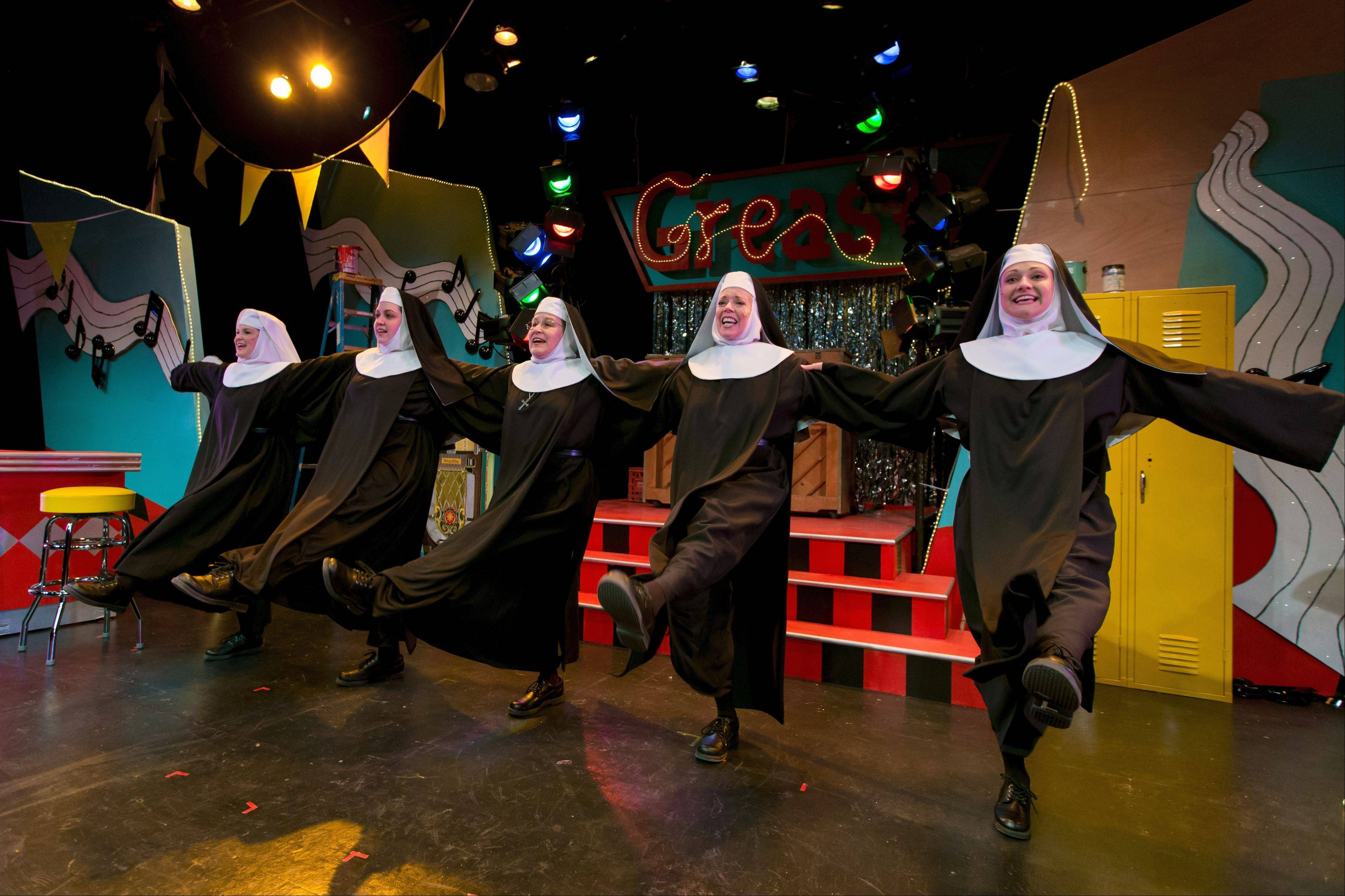 "Five nuns from Hoboken, N.J., perform in a fundraising revue in Fox Valley Repertory's ""Nunsense,"" featuring Sister Mary Leo (Kristine Burdi), left, Sister Mary Hubert (Missy Aguilar), Sister Mary Regina (Patti Roeder), Sister Mary Robert Anne (Jane Brewer) and Sister Mary Amnesia (Monica Szaflik)."