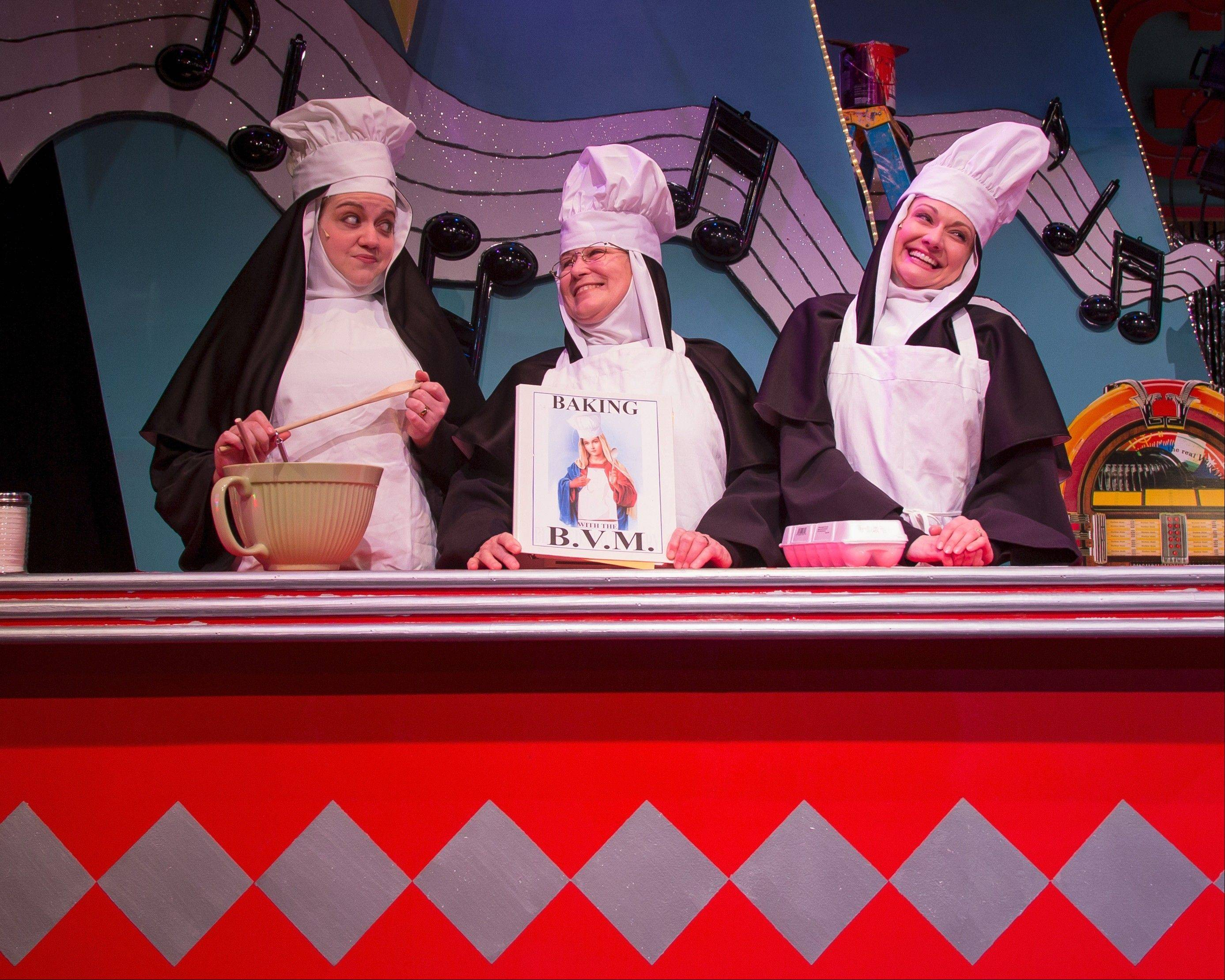 "The cooking show portion of the fundraising revue in Fox Valley Repertory's ""Nunsense,"" which features Sister Mary Hubert (Missy Aguilar), left, Sister Mary Regina (Patti Roeder) and Sister Mary Amnesia (Monica Szaflik)."