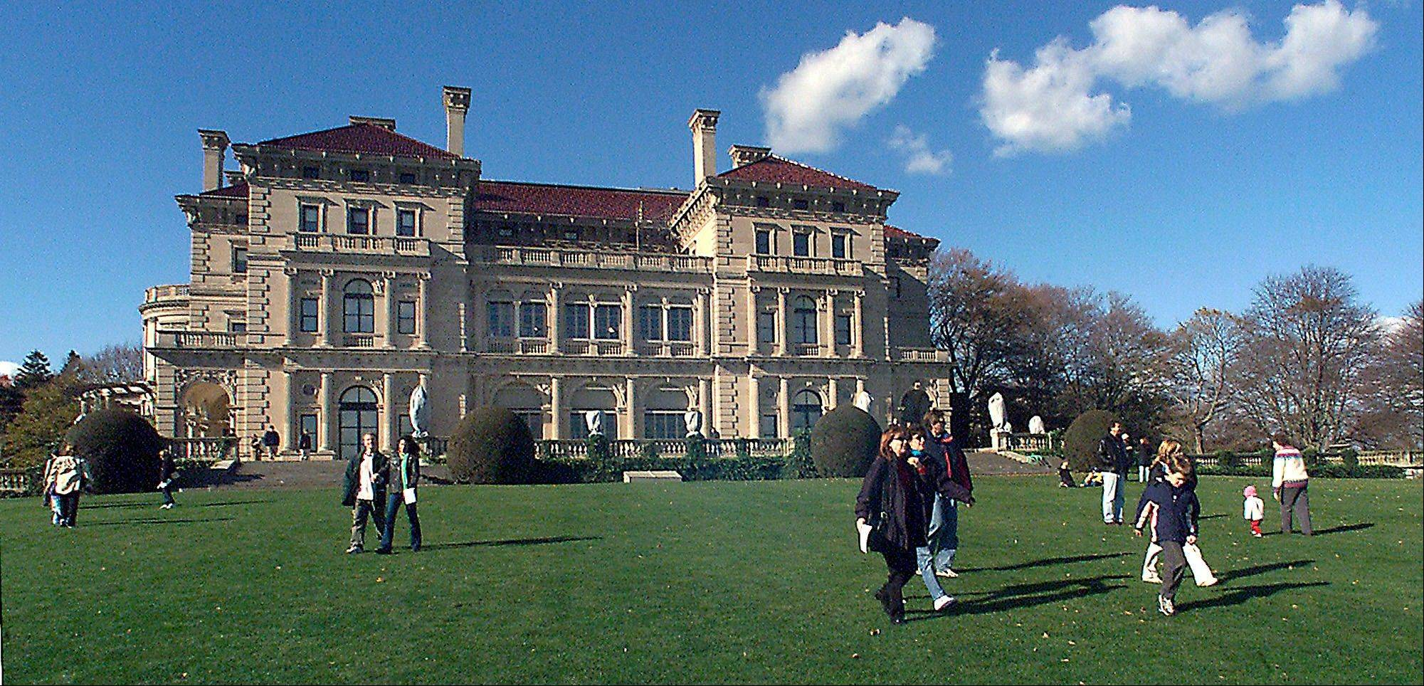 Visitors take advantage of free admission to tour The Breakers mansion in Newport, R.I. The Preservation Society of Newport County proposed building a visitor center in 2014 that would sit on the mansion's grounds. The society said it would be unobtrusive and would provide necessary services that currently are lacking at the popular tourist attraction. Some nearby residents are fighting the plan.