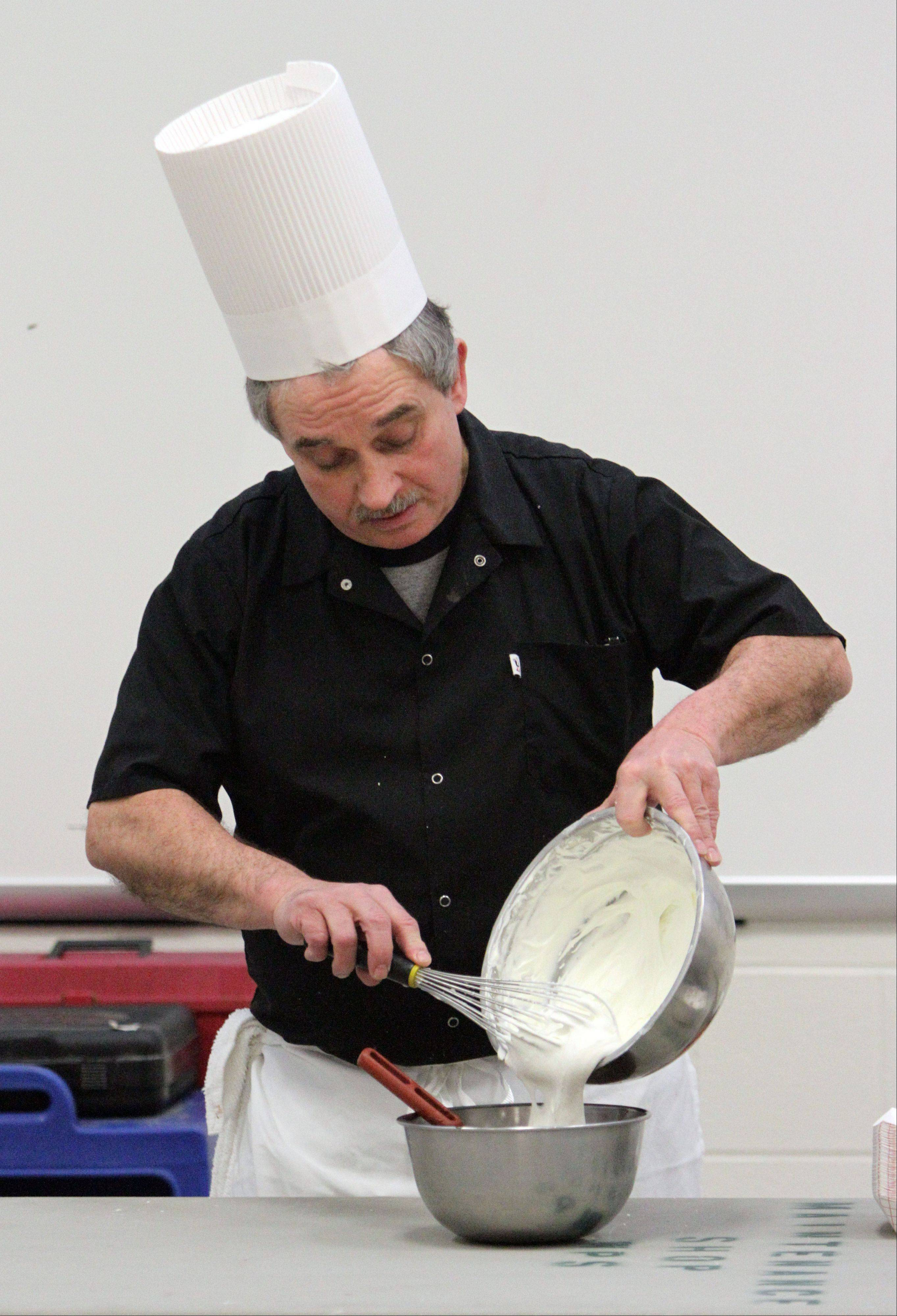 Claude Bouteille, owner/chef of Taste of Paris Restaurant in Mundelein, whips up a chocolate mousse during Thursday's demonstration for sixth-, seventh- and eighth-graders in Maureen Fischer Rivkin's French class at Thomas Jefferson School in Waukegan.