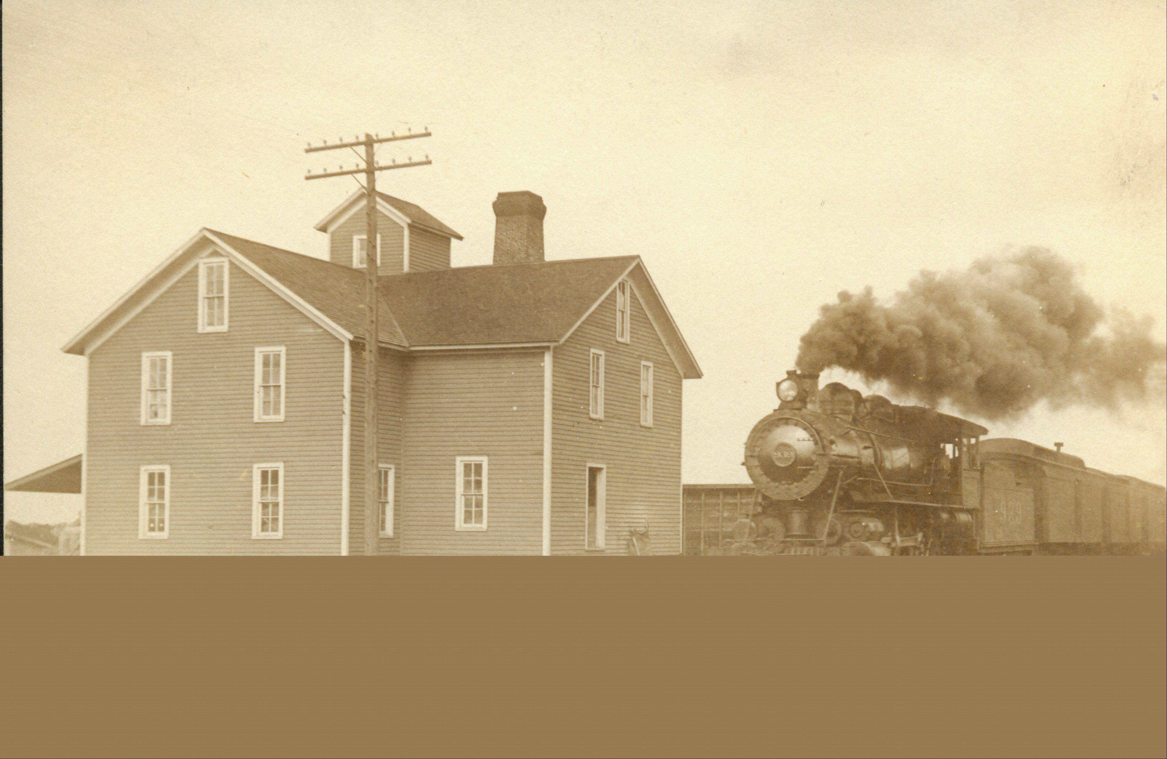 A steam-powered train passes by a grain mill along eastern Bartlett Avenue in this 1900s-era photo. The Bartlett Depot Museum is ushering in its spring season with exhibits devoted to steam engines.