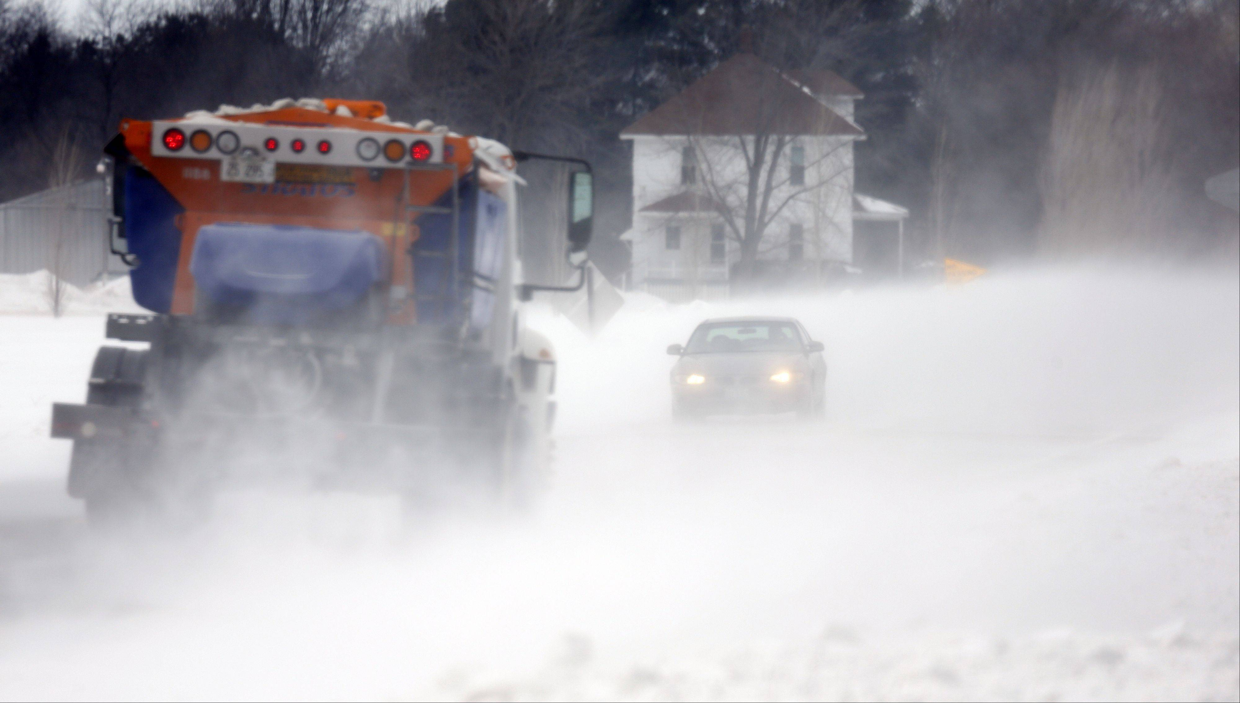 Wind blows snow across Plank Road just east of Route 47 Thursday in Plato Township.