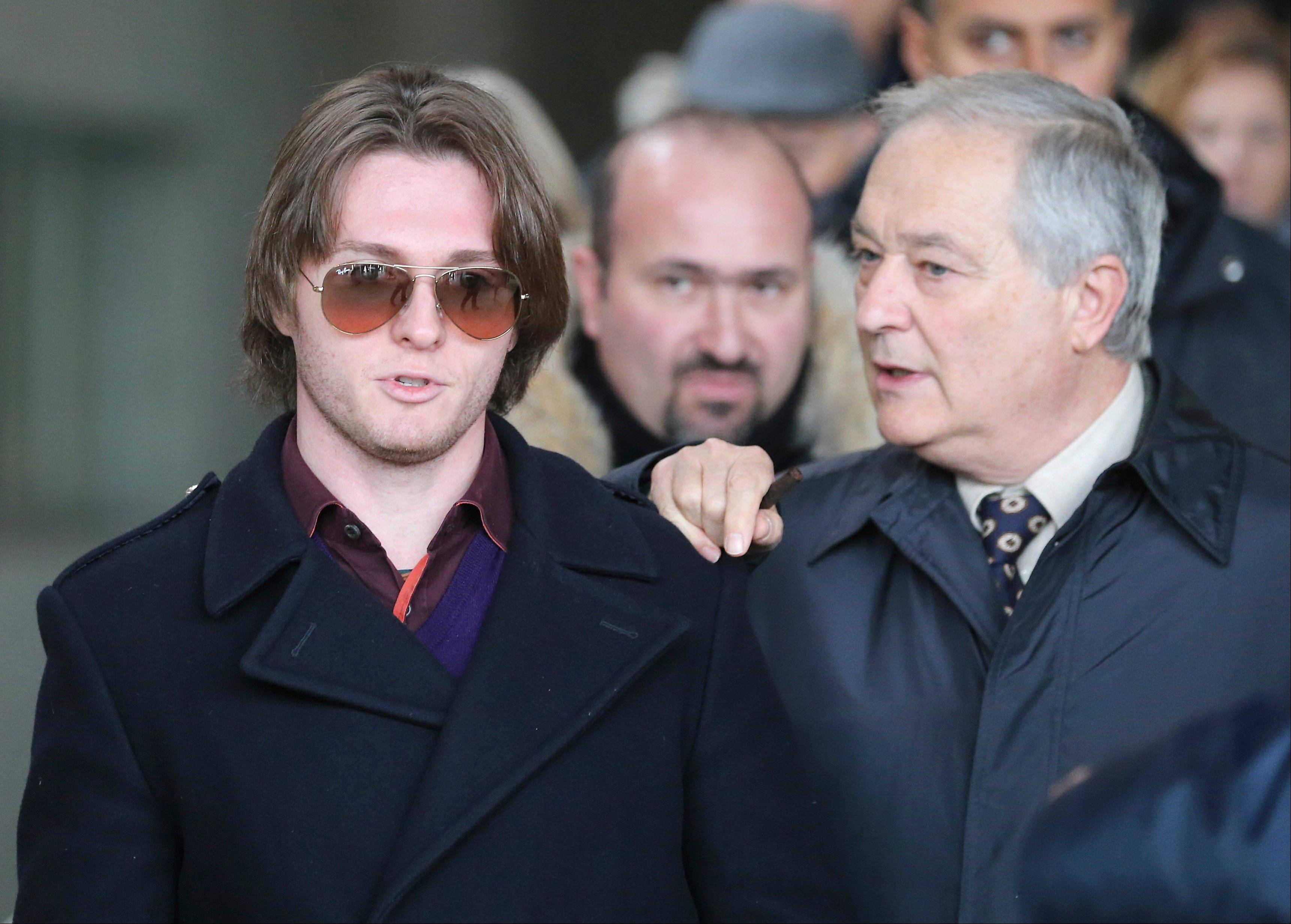Raffaele Sollecito, left, and his father Francesco leave after attending the final hearing before the third court verdict for the murder of British student Meredith Kercher, in Florence, Italy, Thursday, Jan. 30, 2014. The first two trials produced flip-flop verdicts of guilty then innocent for Kercher's former roommate, American student Amanda Knox, who is not attending the hearing, and her former Italian boyfriend, Raffaele Sollecito.