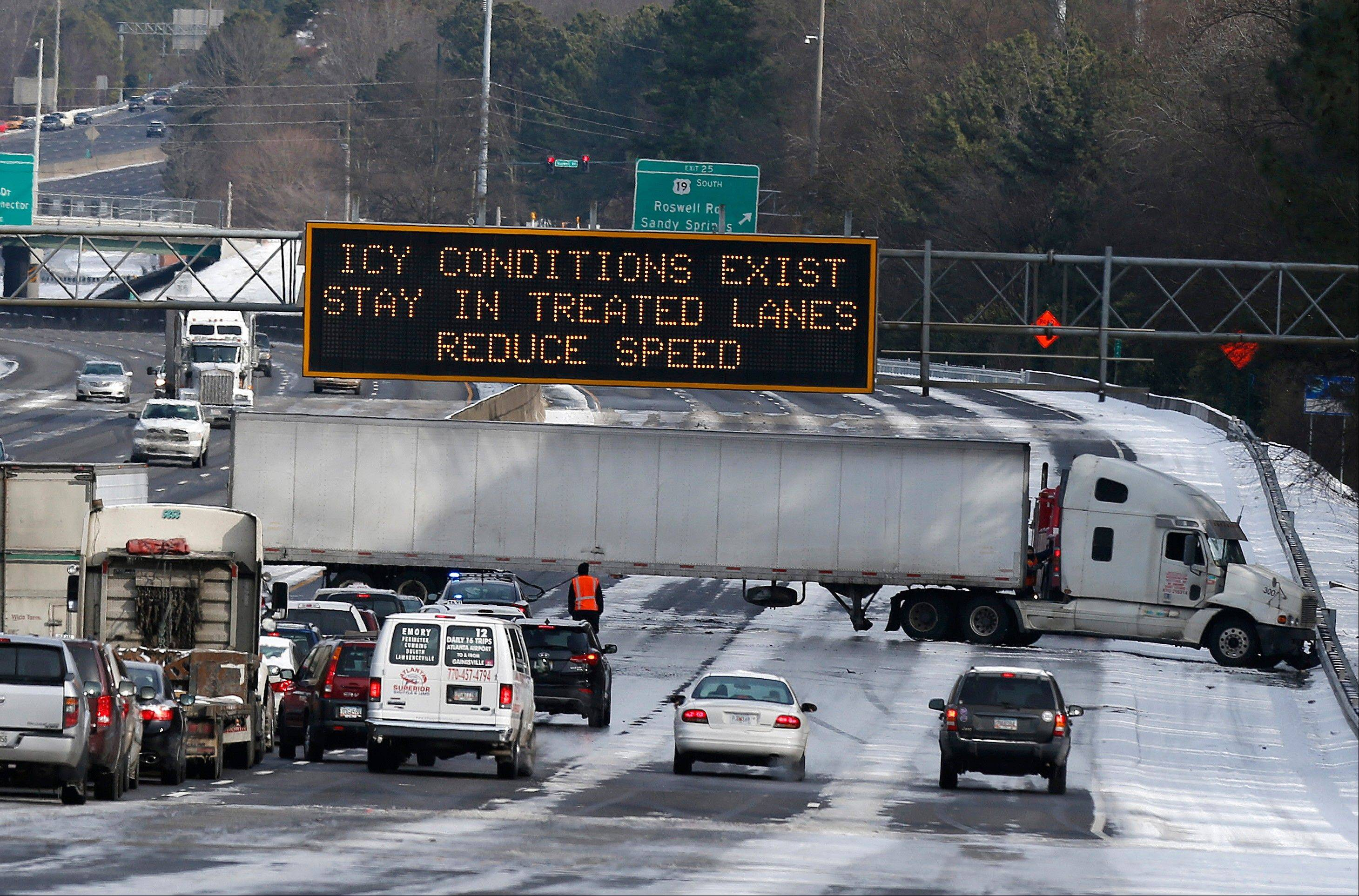 Some interstates around Atlanta remained clogged by jackknifed eighteen-wheelers Wednesday afternoon, more than 24 hours after snow began falling on the city.