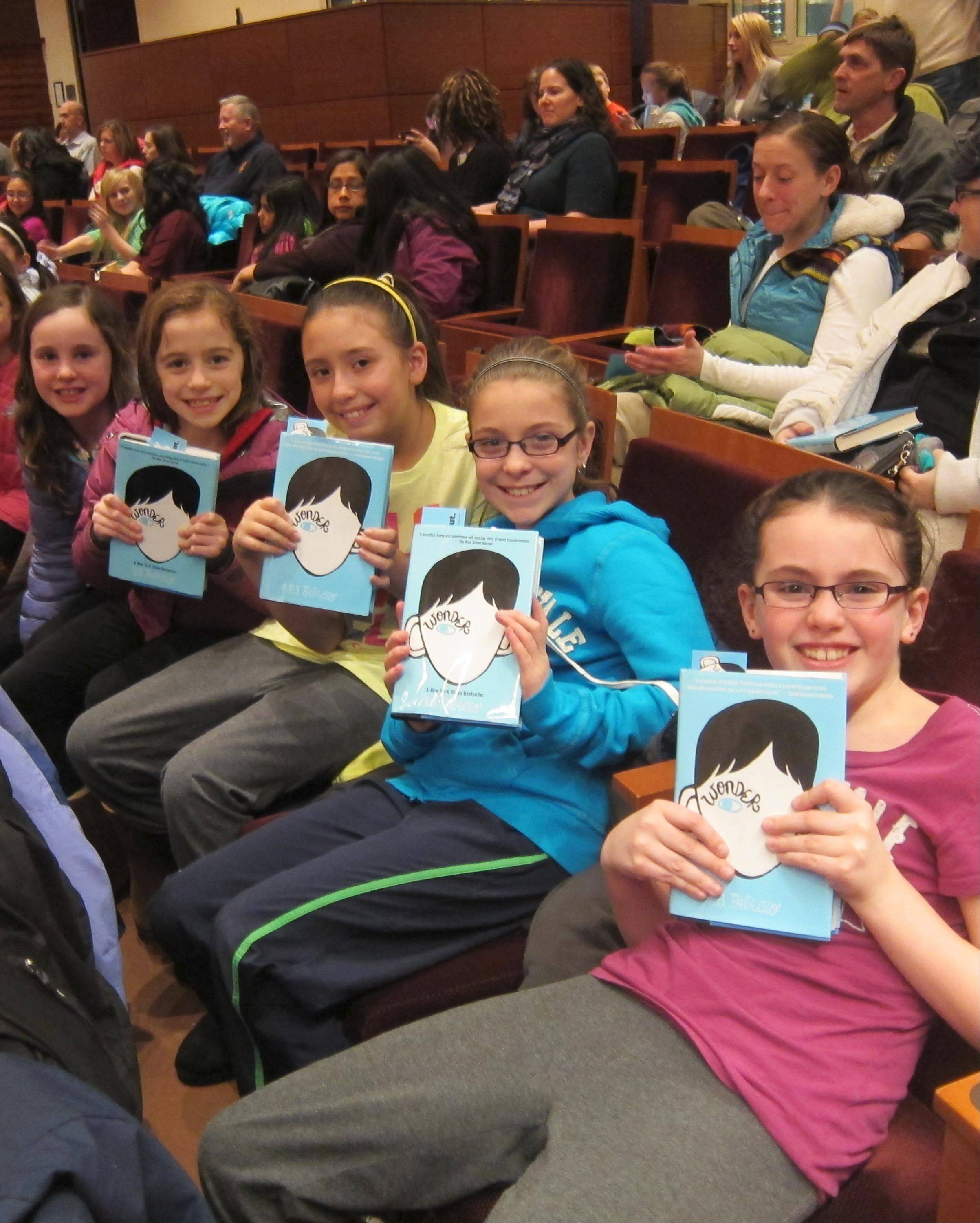 "Naperville students with copies of R.J. Palacio's book ""Wonder"" await an appearance by the author last year as part of the Naperville READS program. This year's program is bringing 12 authors -- the most ever featured in 13 years of Naperville READS -- to town for presentations in schools and for the public."