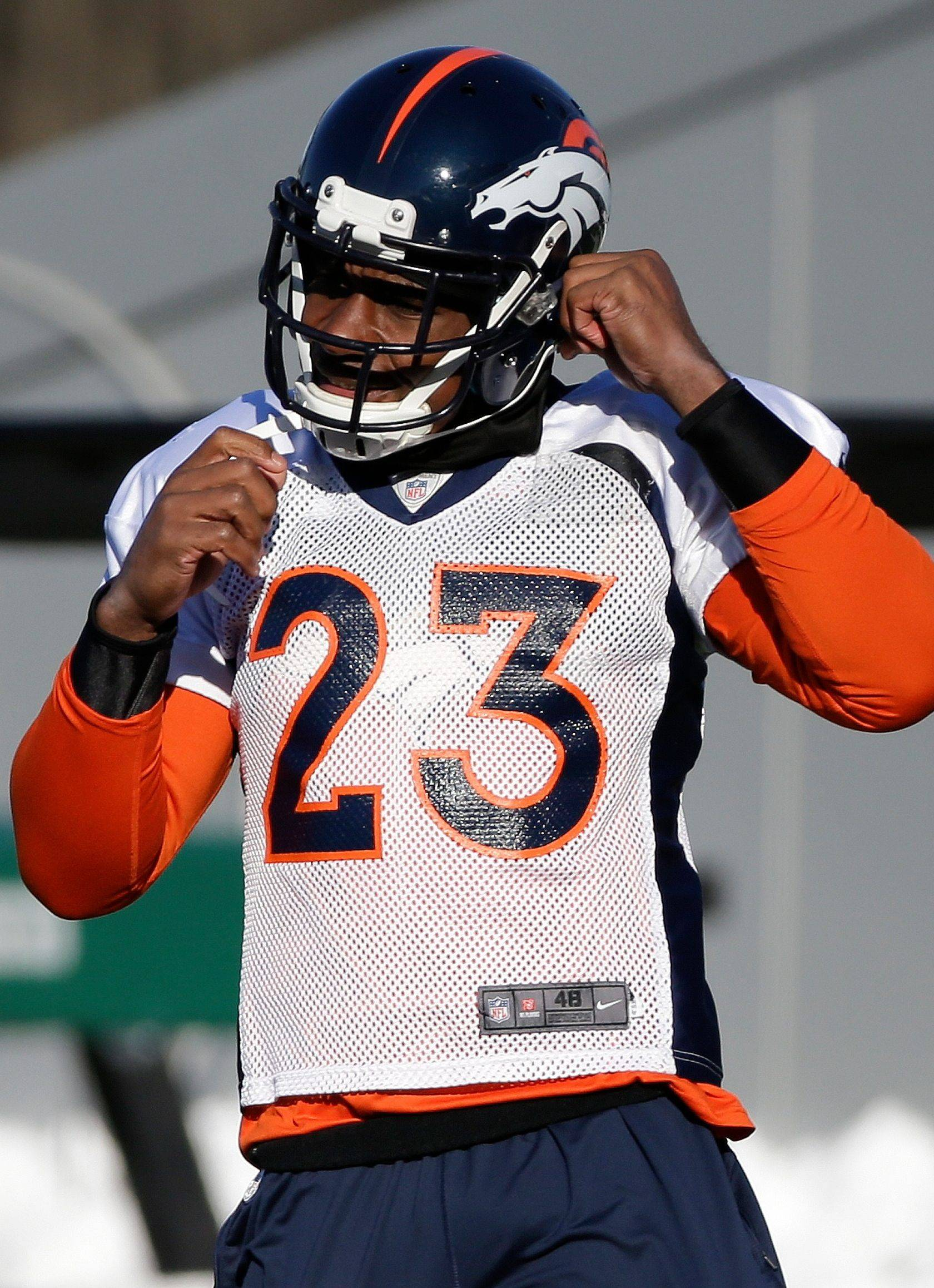 Denver Broncos cornerback Quentin Jammer straps on his helmet during practice Wednesday, Jan. 29, 2014, in Florham Park, N.J. The Broncos are scheduled to play the Seattle Seahawks in the NFL Super Bowl XLVIII football game Sunday, Feb. 2, in East Rutherford, N.J.