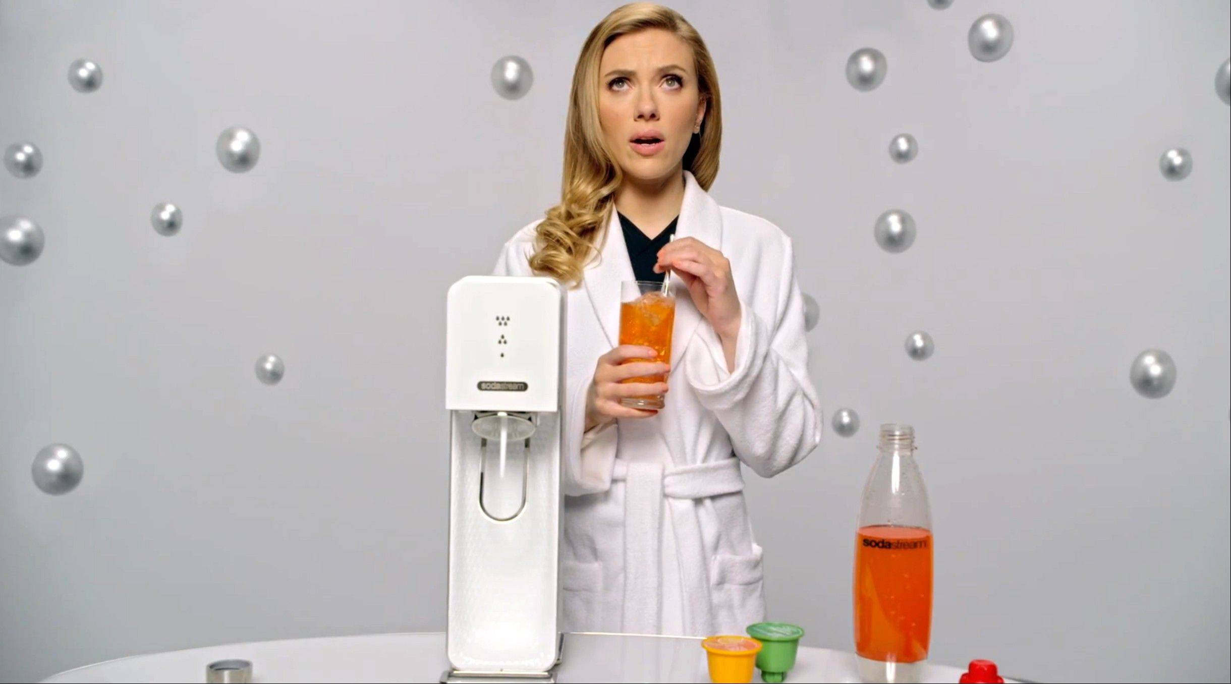 SodaStream�s ad features �Her� actress Scarlett Johansson promoting its at-home soda maker and will run in the fourth quarter. The ad, which promotes the product as a healthier and less wasteful way to make soda, made waves ahead of the game when the company said it would delete its last line, �Sorry, Coke and Pepsi,� at a request by Fox.