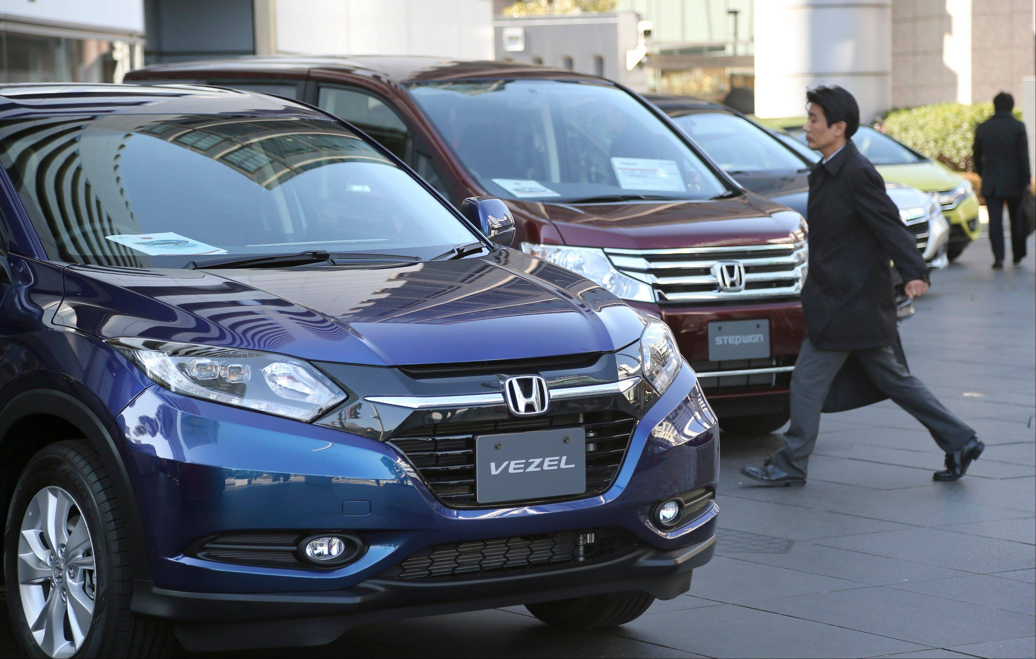 Honda�s quarterly profit doubled from a year earlier as sales got a big perk from a weak yen.