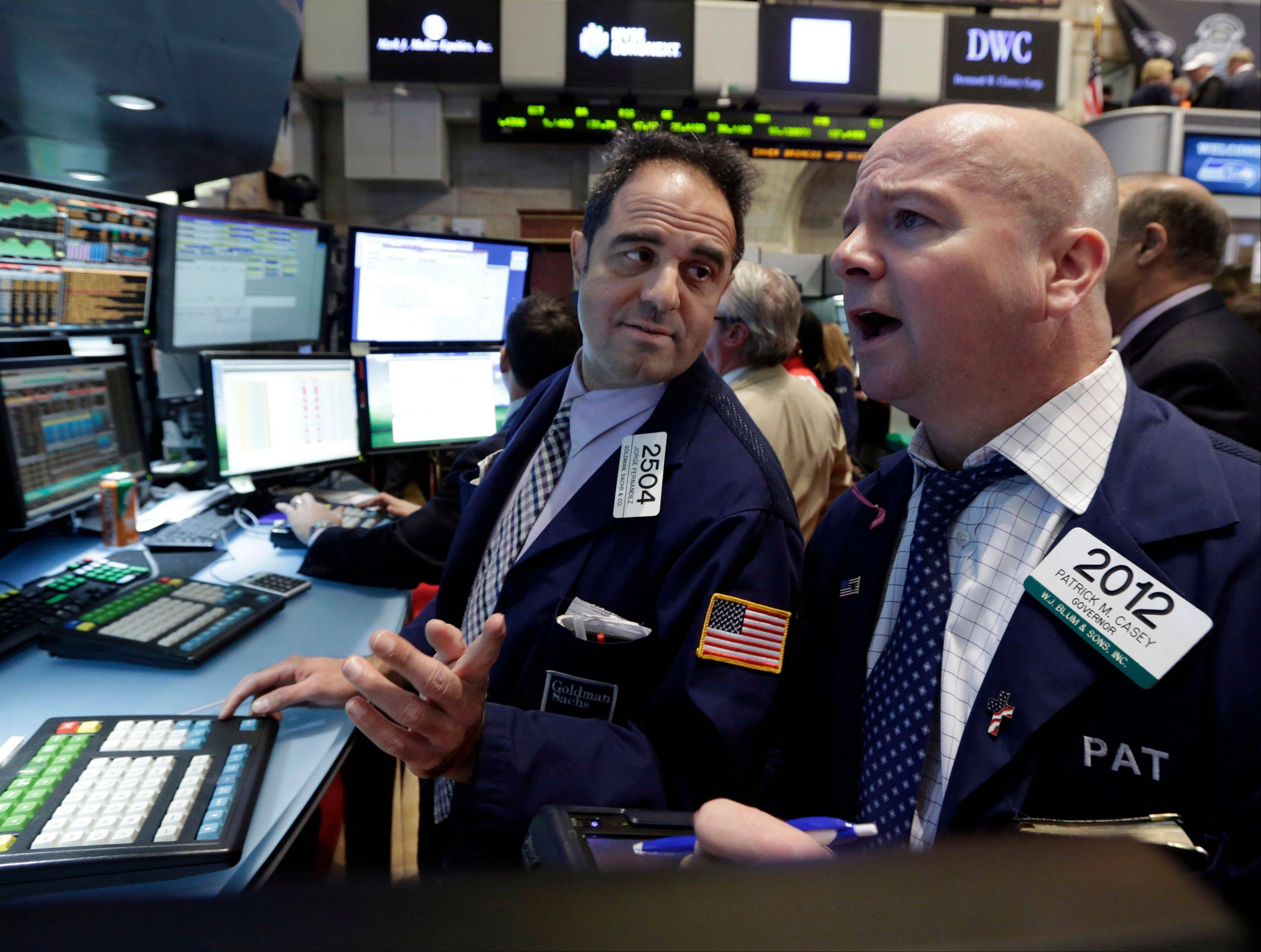 Stocks fell sharply Friday, as investors fretted over disappointing earnings from companies like Amazon.com and more trouble in overseas markets.