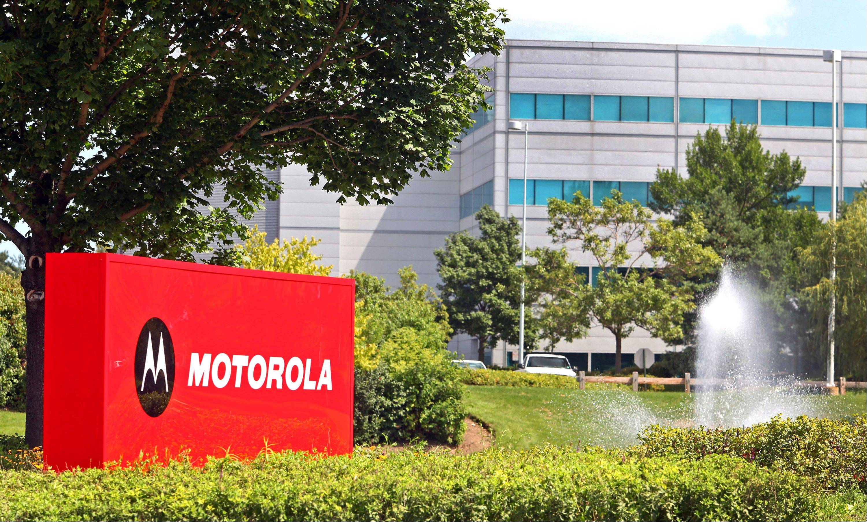 Lenovo's planned acquisition of Motorola Mobility Holdings Inc. won't affect the company's departure from this Libertyville campus for offices in Chicago.
