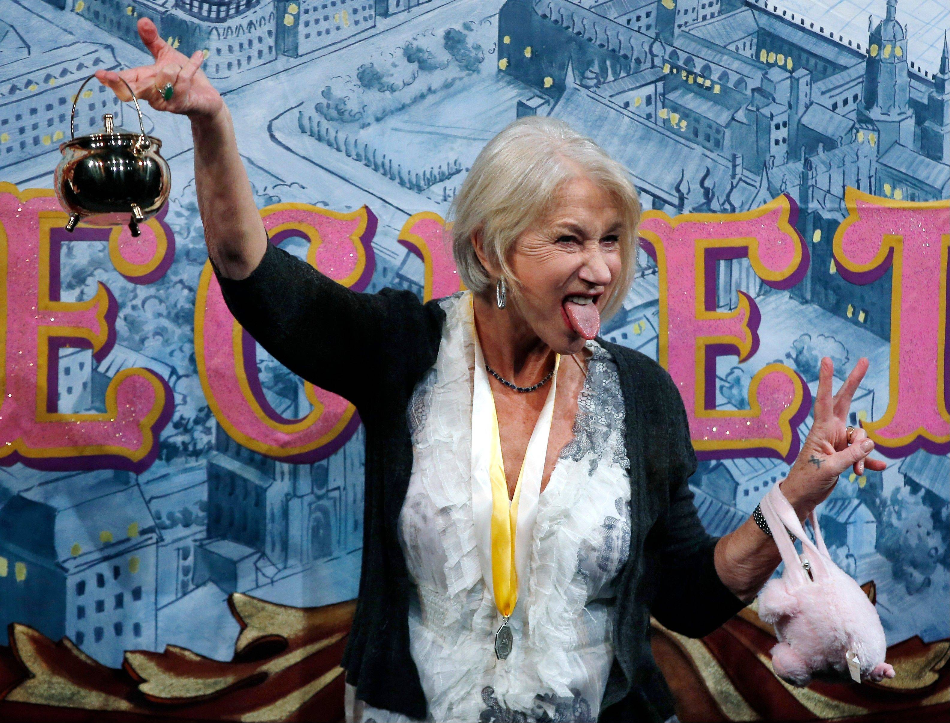 Actress Helen Mirren holds the Hasty Pudding Pot aloft and sticks her tongue out during her roast as woman of the year by Harvard University's Hasty Pudding Theatricals in Cambridge, Mass., Thursday.