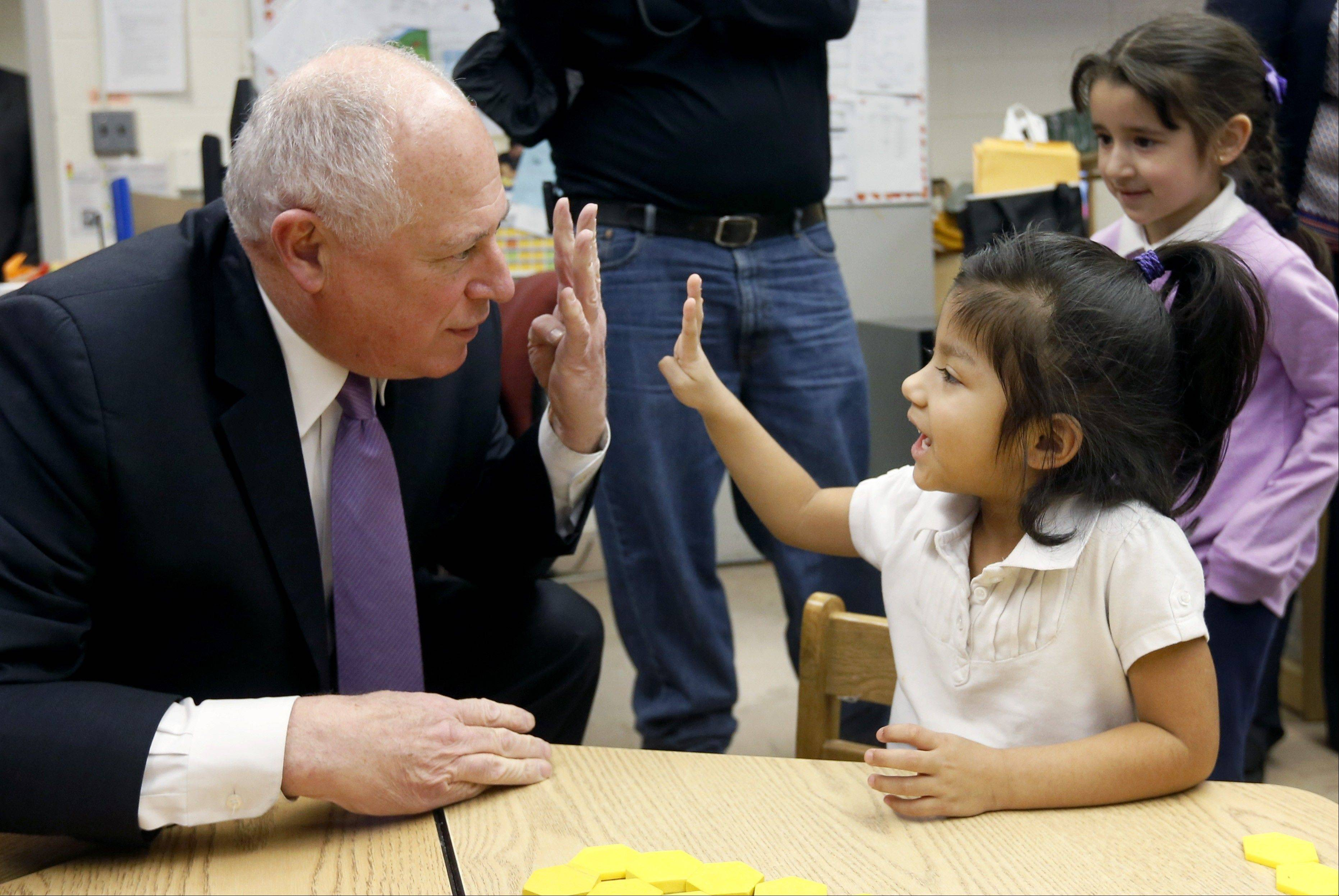 Gov. Pat Quinn asks Anna Munoz her age as she replies enthusiastically, 4, on Thursday at the Edwards Center for Young Learners in Chicago.
