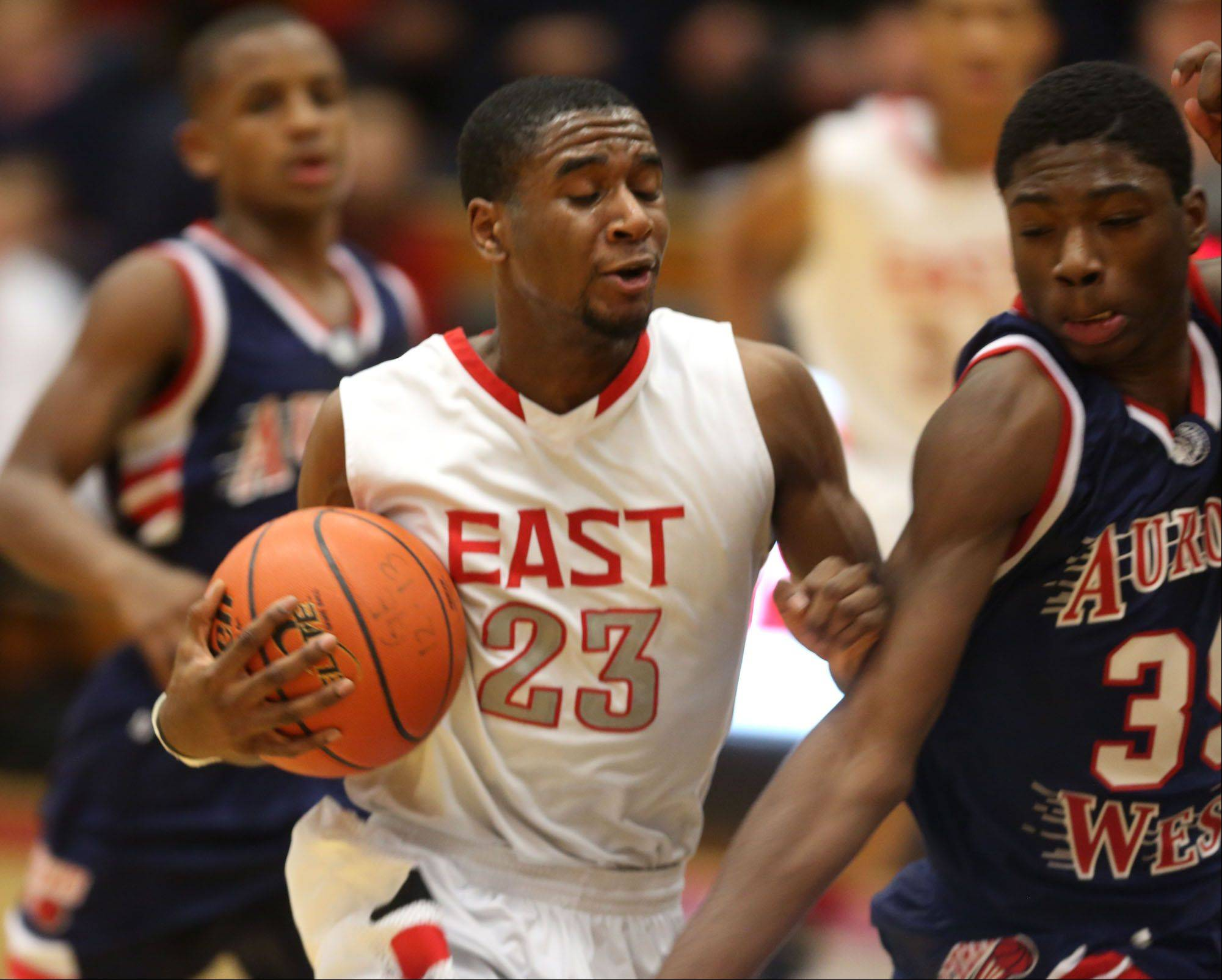 Glenbard East�s Jaron Hall moves the ball upcourt against West Aurora.