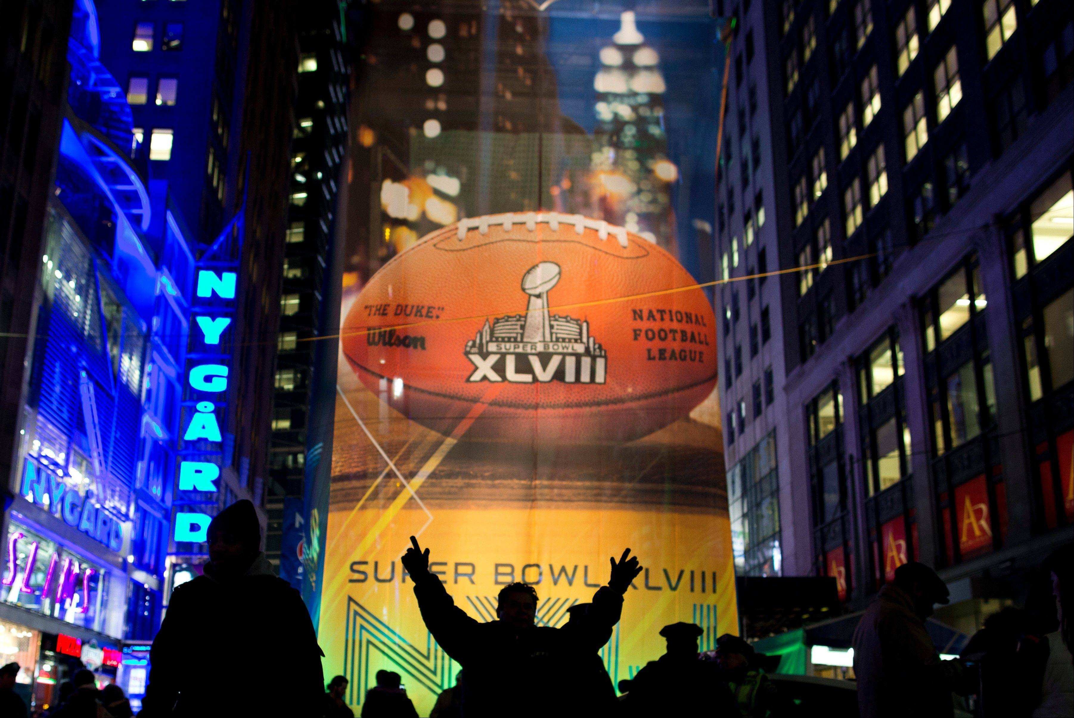 Fans gather on the Super Bowl Boulevard in Times Square on Friday in New York. The Seattle Seahawks will play the Denver Broncos on Sunday in Super Bowl XLVIII in East Rutherford, N.J.