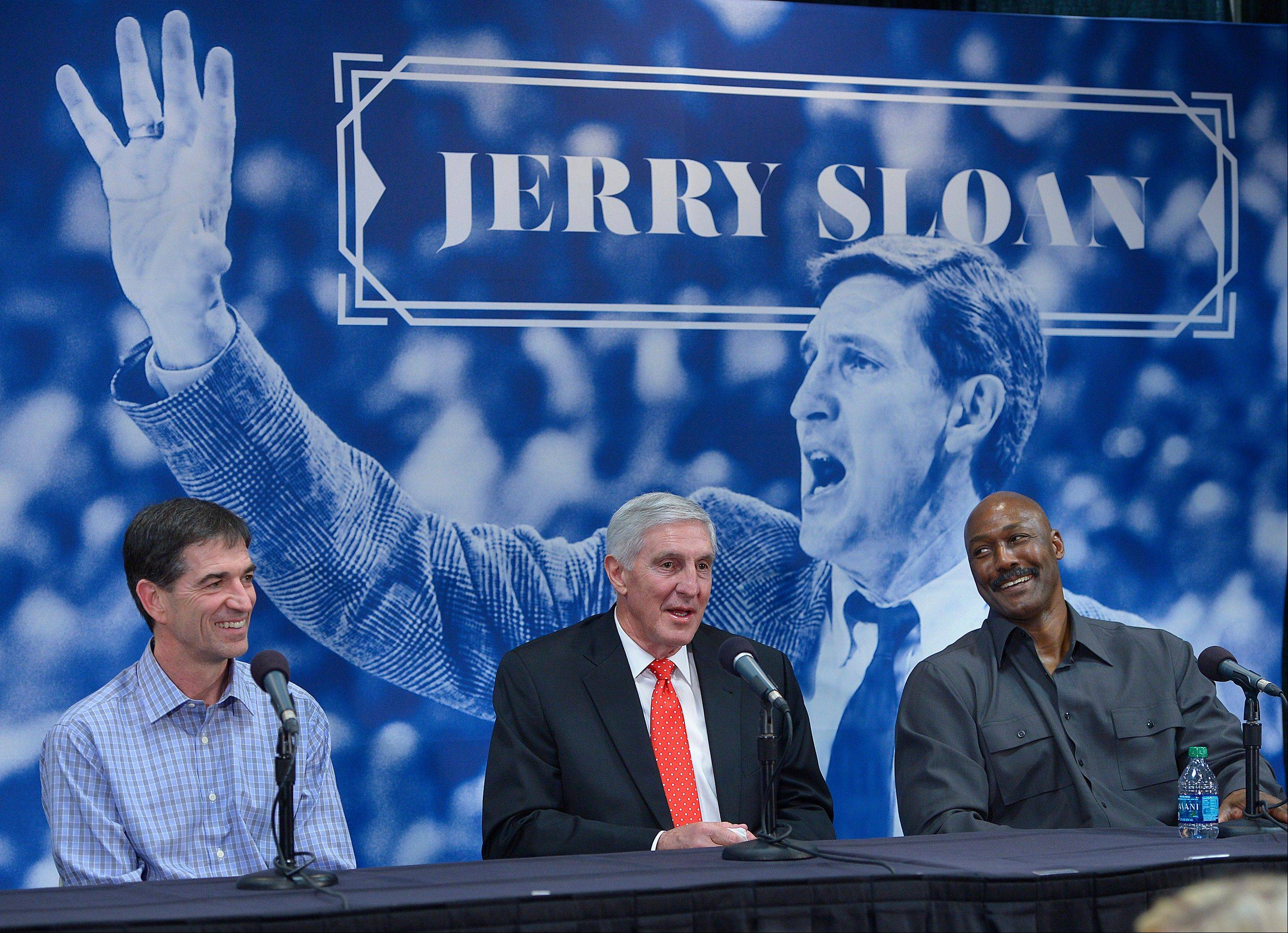 John Stockton, left, and Karl Malone laugh during a news conference to honor former Utah Jazz coach Jerry Sloan on Friday in Salt Lake City.