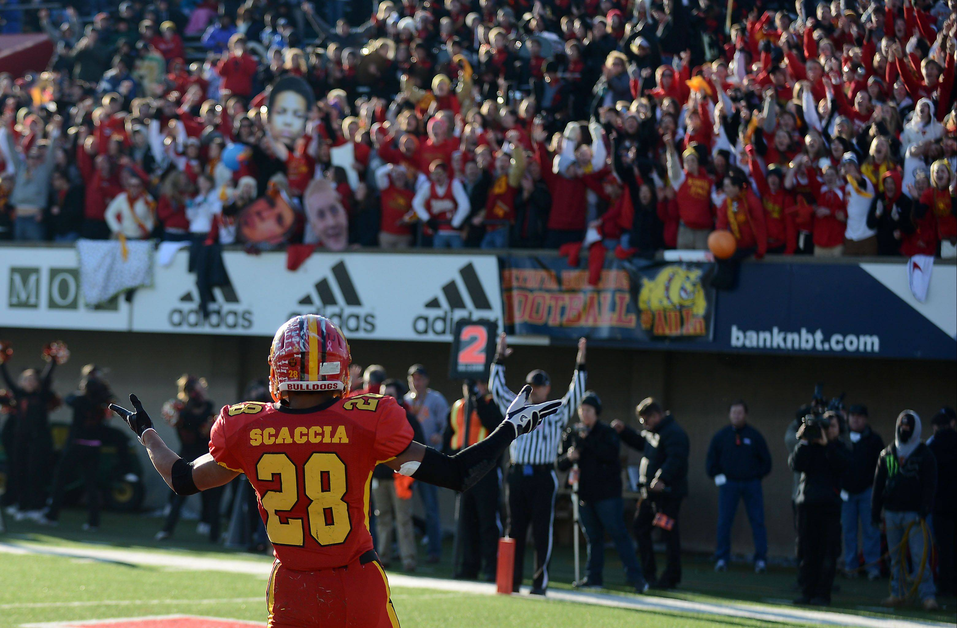 Batavia's Anthony Scaccia plays to the crowd after scoring a first-quarter touchdown against Richards during last November's Class 6A state championship game in DeKalb.