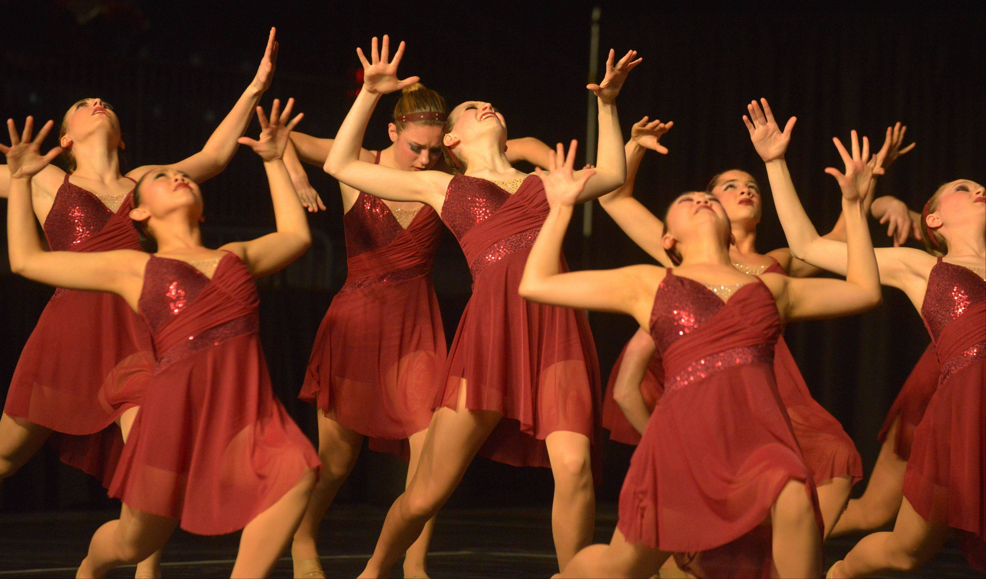 The Libertyville High School dance team takes part in the Competitive Dance preliminary round Friday at U.S. Cellular Coliseum in Bloomington.