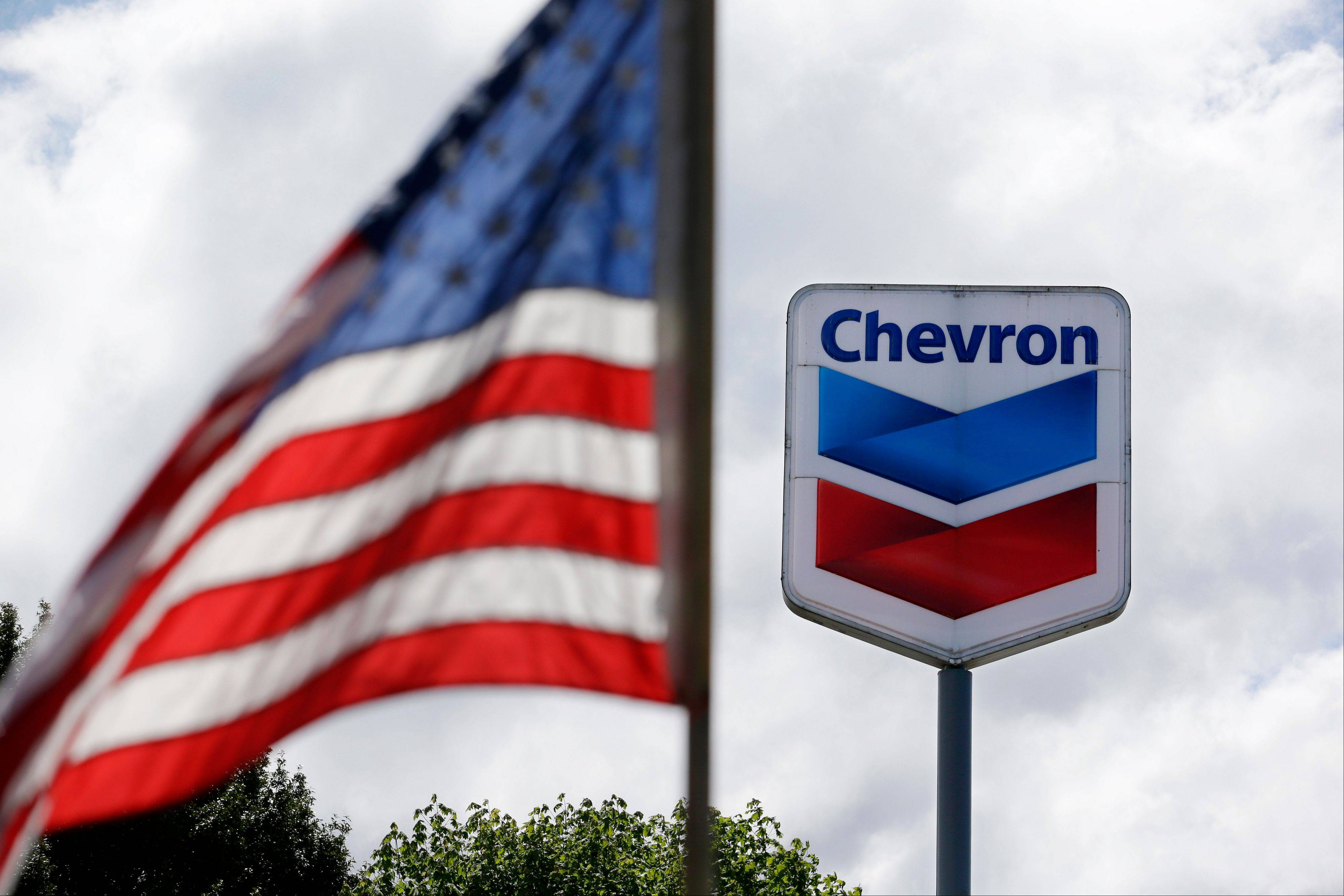 Chevron says profit fell 32 percent in the fourth quarter on lower oil and gas production and lower prices for refined fuels relative to the cost of crude.