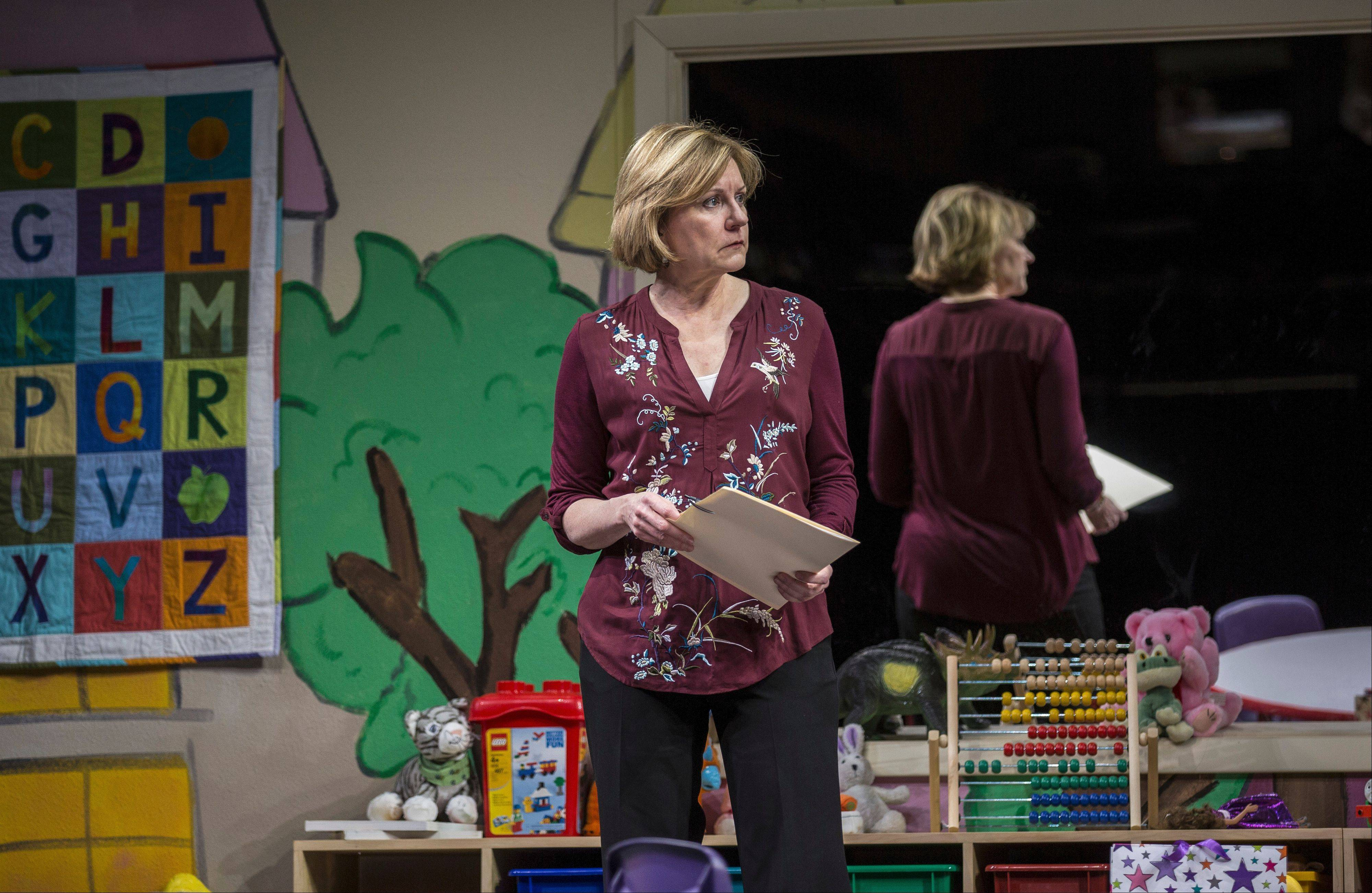 "Mary Beth Fisher is marvelous as a social worker whose recommendation can determine the fate of an infant in Rebecca Gilman's ""Luna Gale,"" in its world premiere at Goodman Theatre."