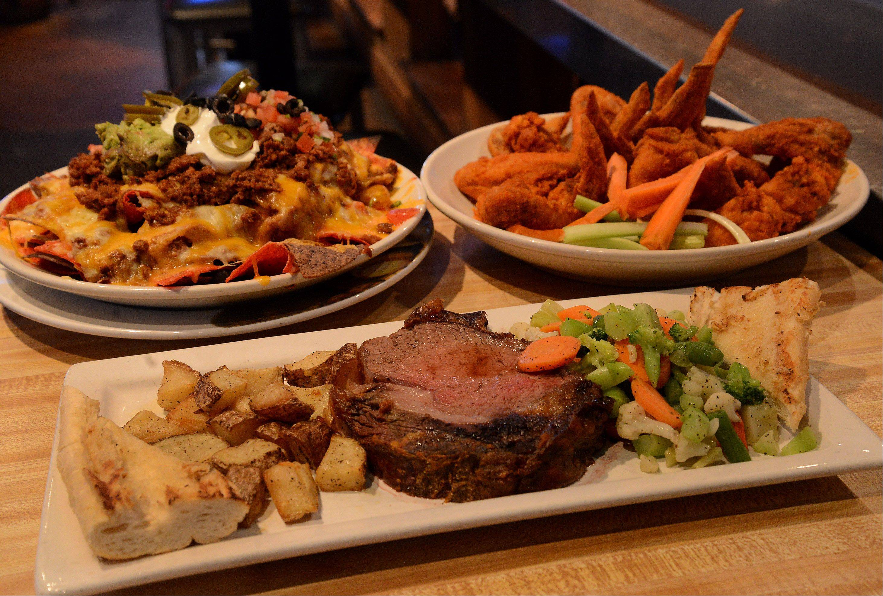 Watch the Super Bowl with Ultimate Nachos, Sudden Death Wings and 16-ounce prime rib at Real Time Sports in Elk Grove Village.