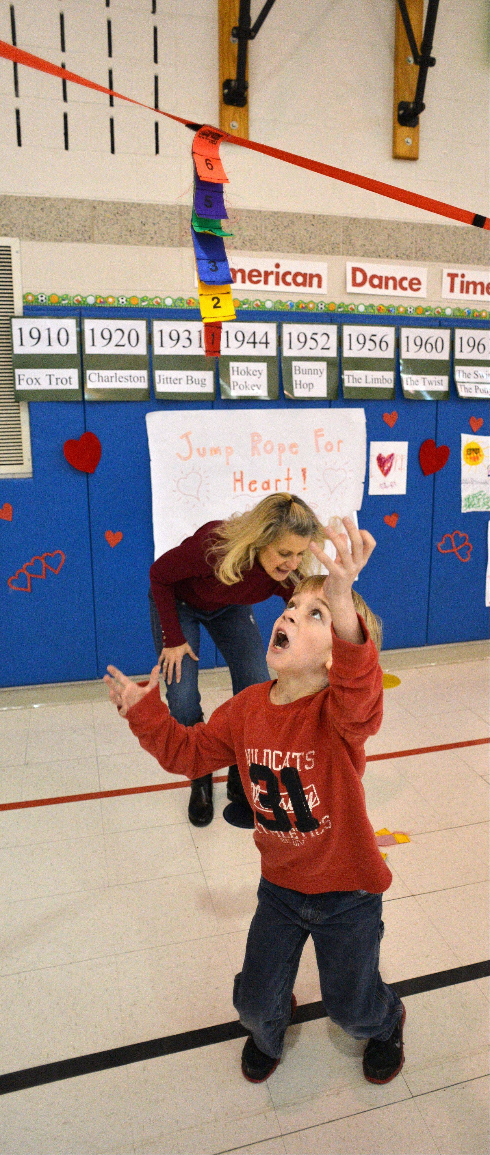 Brennan Johnson eyes the target Friday and prepares to jump to grab the flag during Longfellow School's Jump Rope for Heart program.