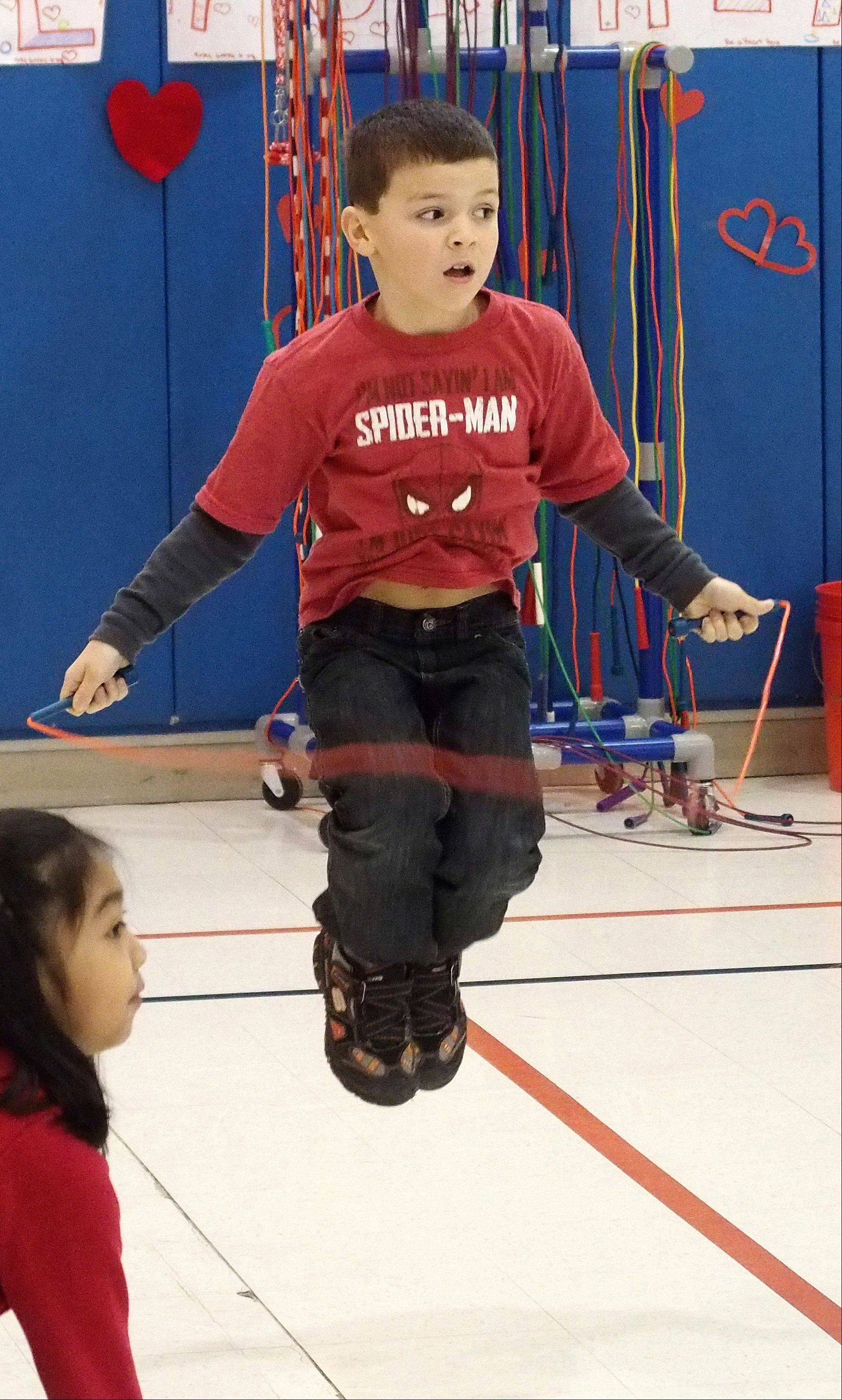 Thomas Zapata jumps around Friday during Longfellow School's Jump Rope for Heart program in Wheaton.