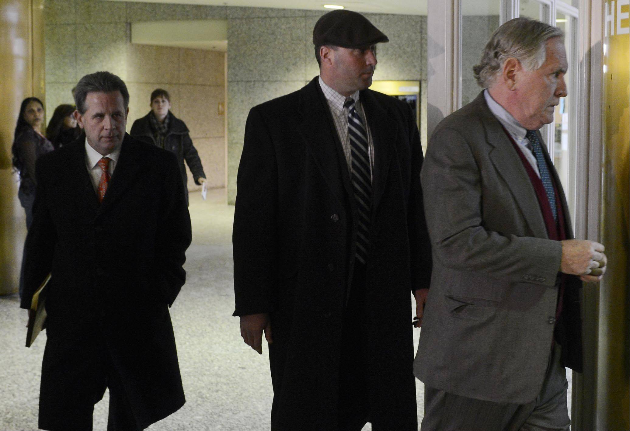 Richard Vanecko, middle, leaves the Rolling Meadows Courthouse Friday after pleading guilty to involuntary manslaughter in the death of David Koschman of Mount Prospect.