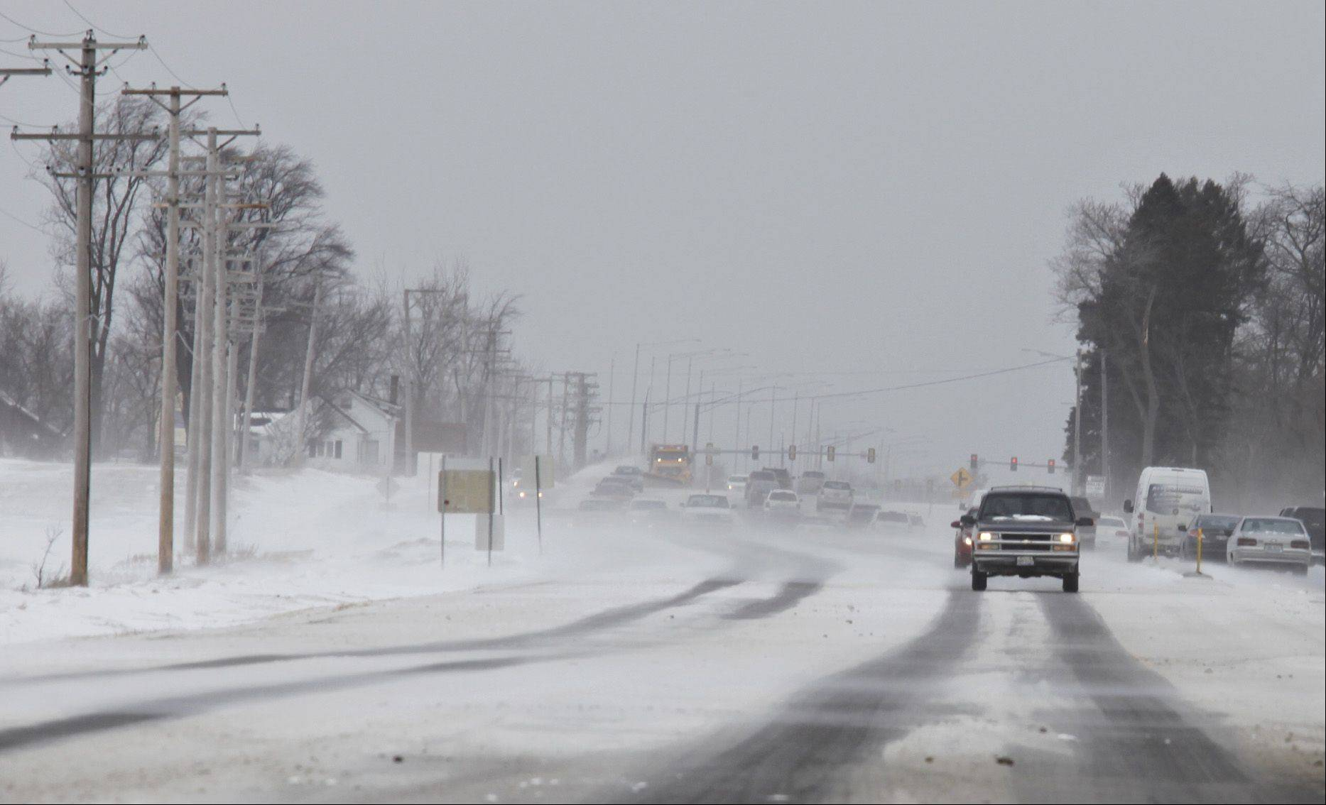 Traffic heads south last week on Randall Road Friday in Carpentersville as wind-blown snow creates only narrow strips of exposed pavement on which to drive. Will it be like this again this weekend?