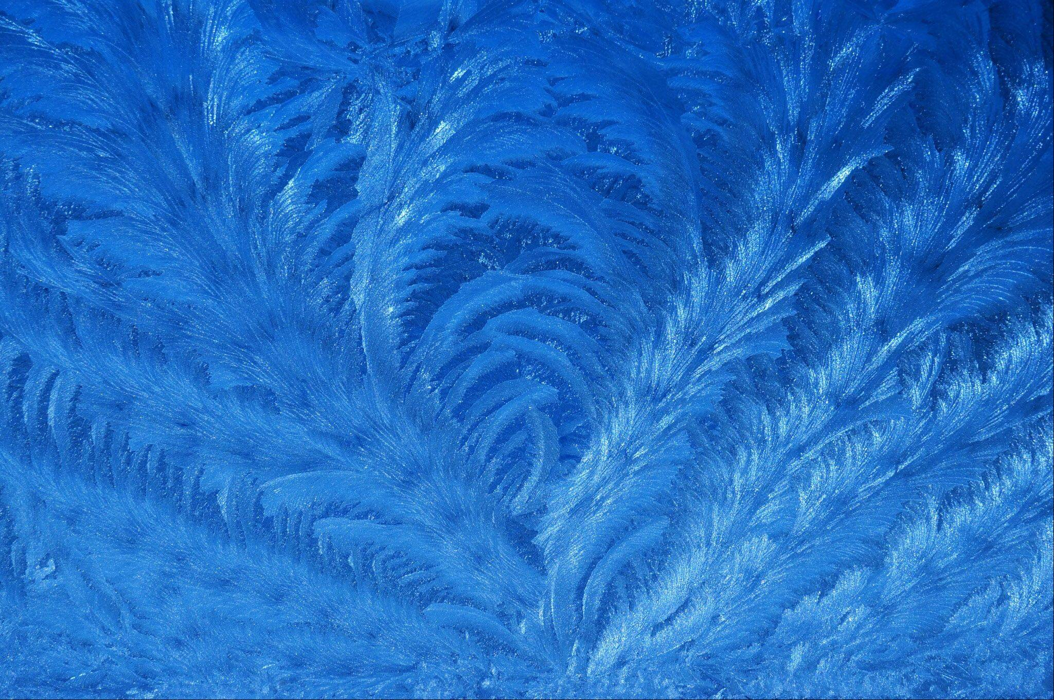 During our recent record-setting cold spell I spent some time photographing the frost patterns on our bedroom windows. This photo was one of my favorites, reminding me of peacock feathers or etchings on fine crystal.