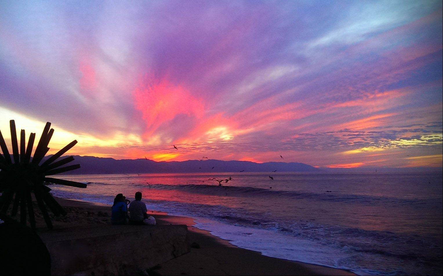 An incredible sunset is captured along the boardwalk on January 15th in Puerto Vallarta.