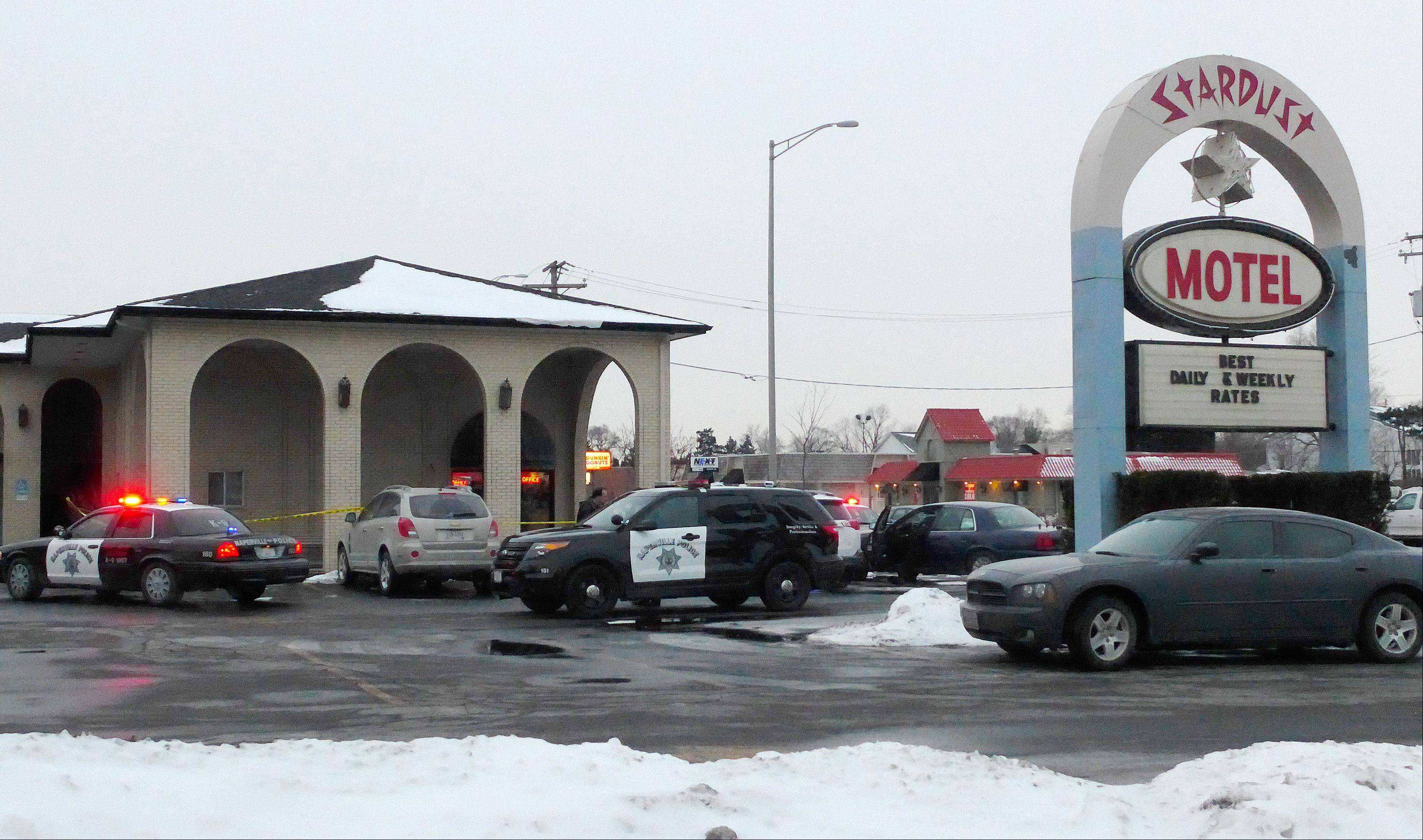 Naperville police investigate an armed robbery Friday at the Stardust Motel on Ogden Avenue.