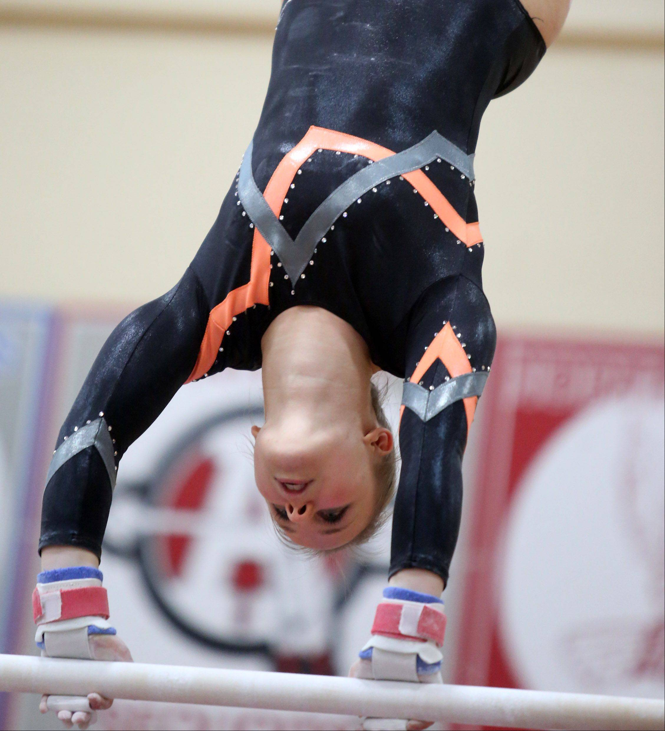 Libertyville's Mariah Lee competes on the uneven parallel bars in a North Suburban Conference girls gymnastics meet on Friday at Libertyville.