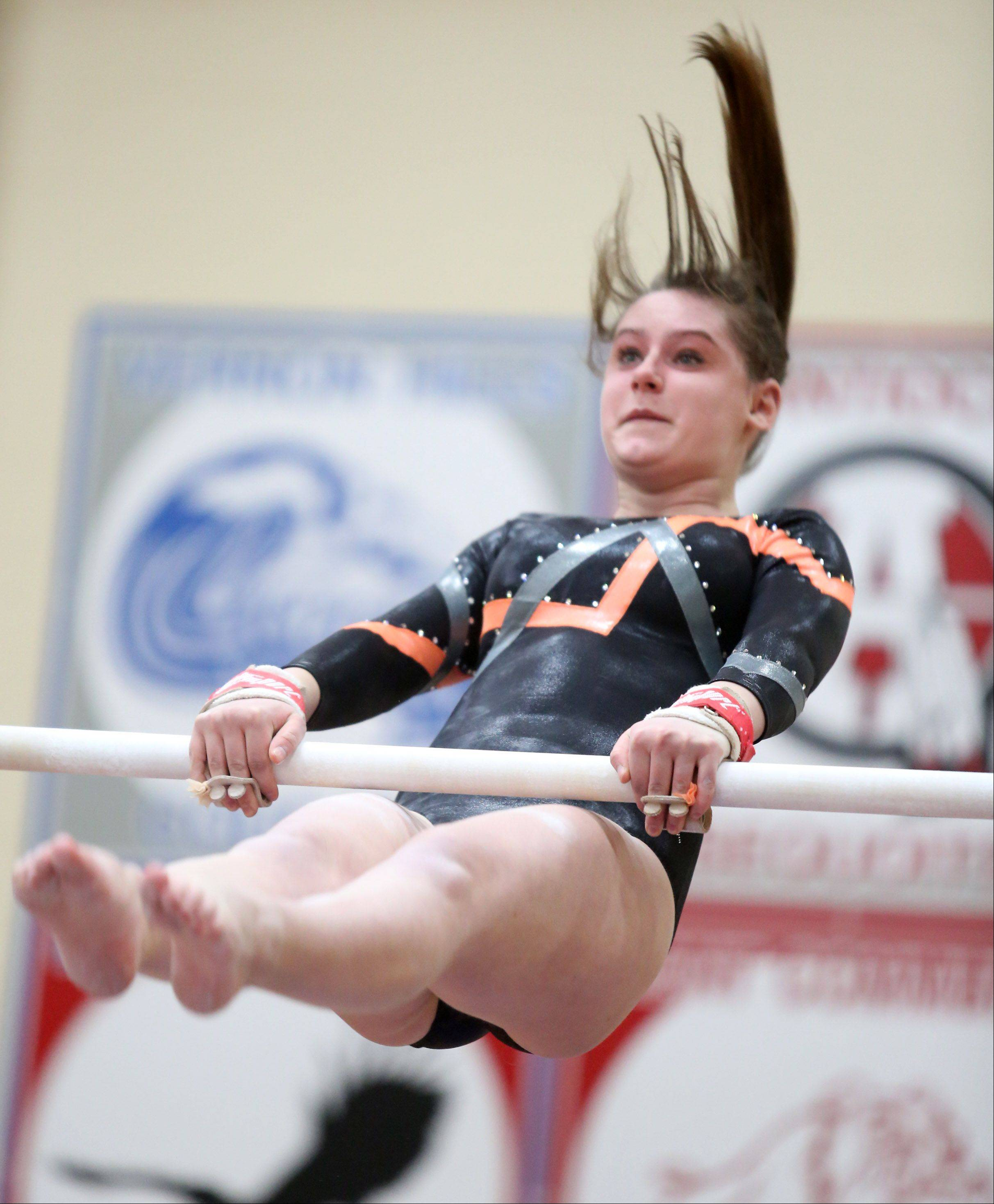 Libertyville's Laney Marth competes on the uneven parallel bars in a North Suburban Conference girls gymnastics meet on Friday at Libertyville.