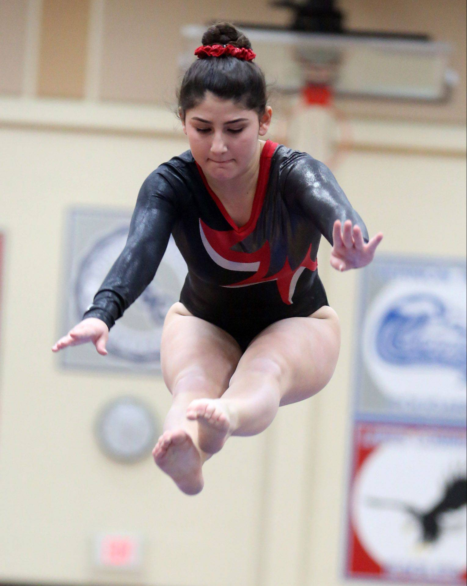 Mundelein's Nicole Ornoff competes on the balance beam in the North Suburban Conference girls gymnastics meet on Friday at Libertyville.