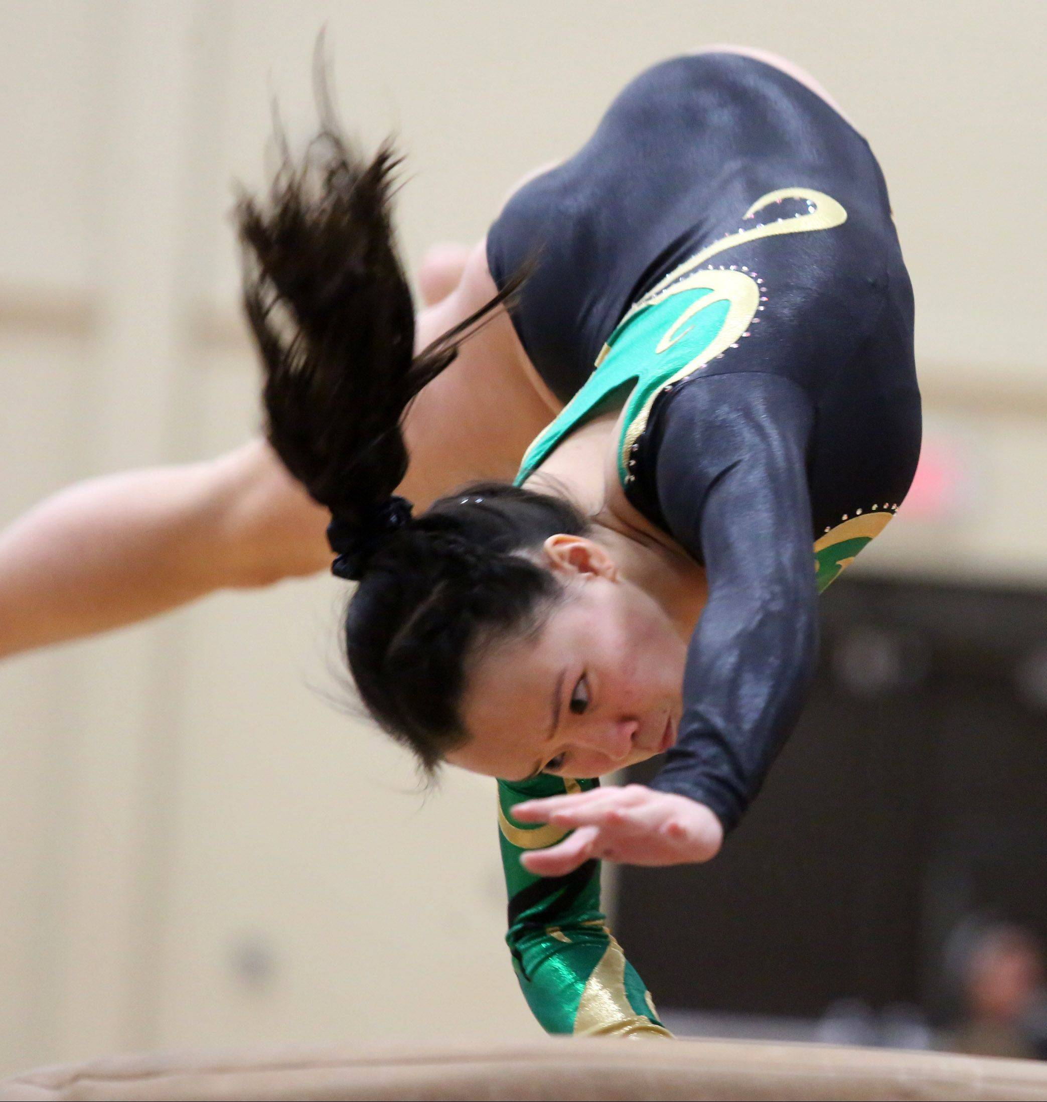 Stevenson's Elizabeth Shank competes on the vault in the North Suburban Conference girls gymnastics meet on Friday at Libertyville.