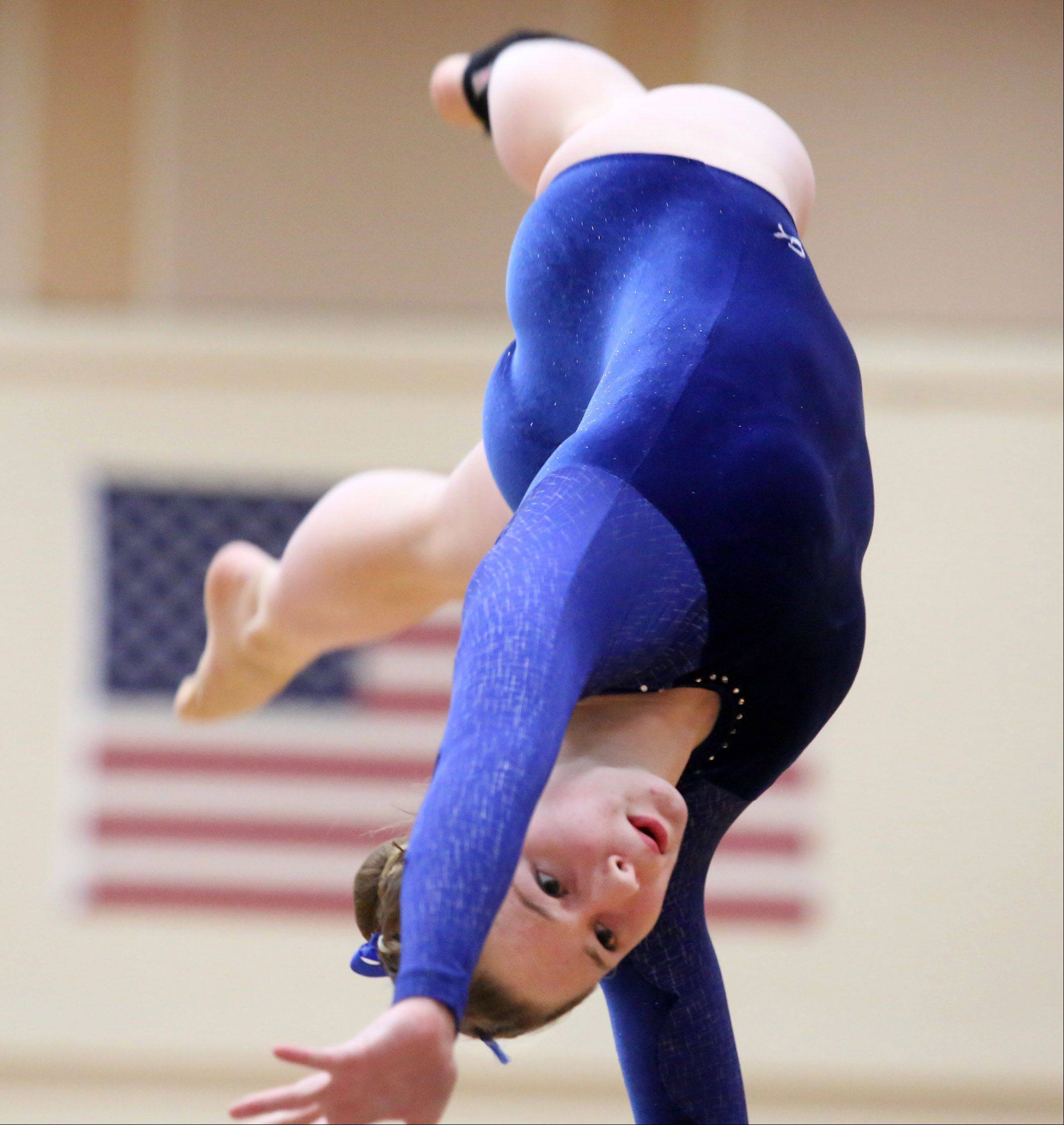 Lakes Community High School's Melissa Lemke competes on the vault in a North Suburban Conference girls gymnastics meet on Friday at Libertyville.
