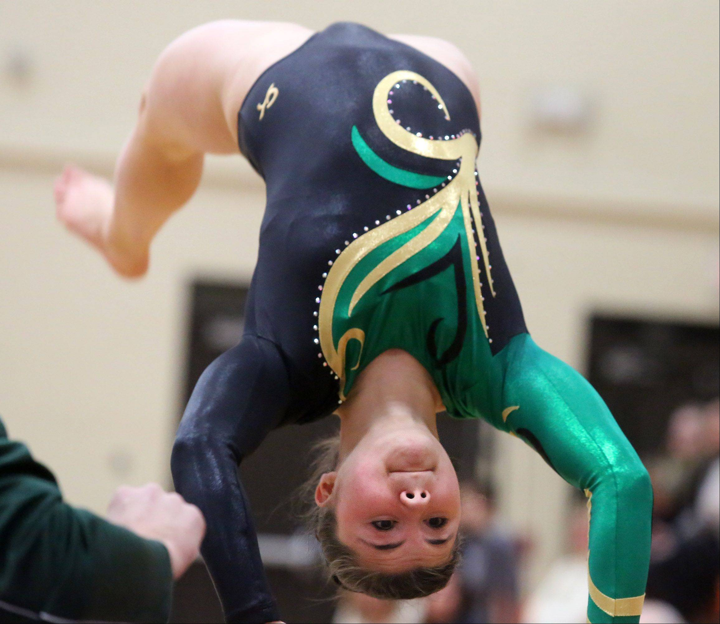 Stevenson's Mikaela Webb competes on the vault in a North Suburban Conference girls gymnastics meet on Friday at Libertyville.