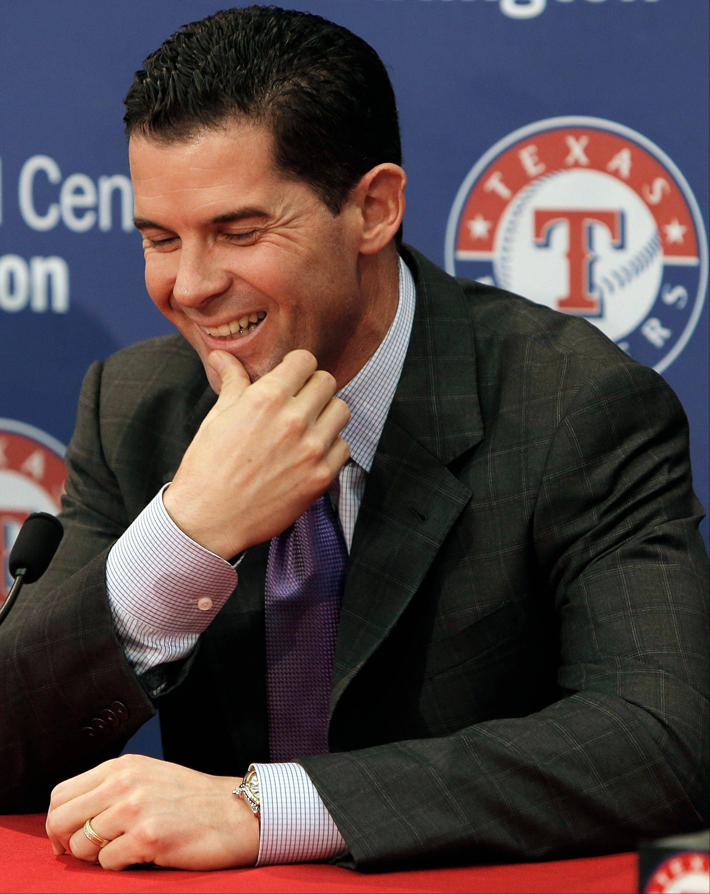 Michael Young answers questions about his retirement from baseball during a news conference Friday at Rangers Ballpark in Arlington, Texas.