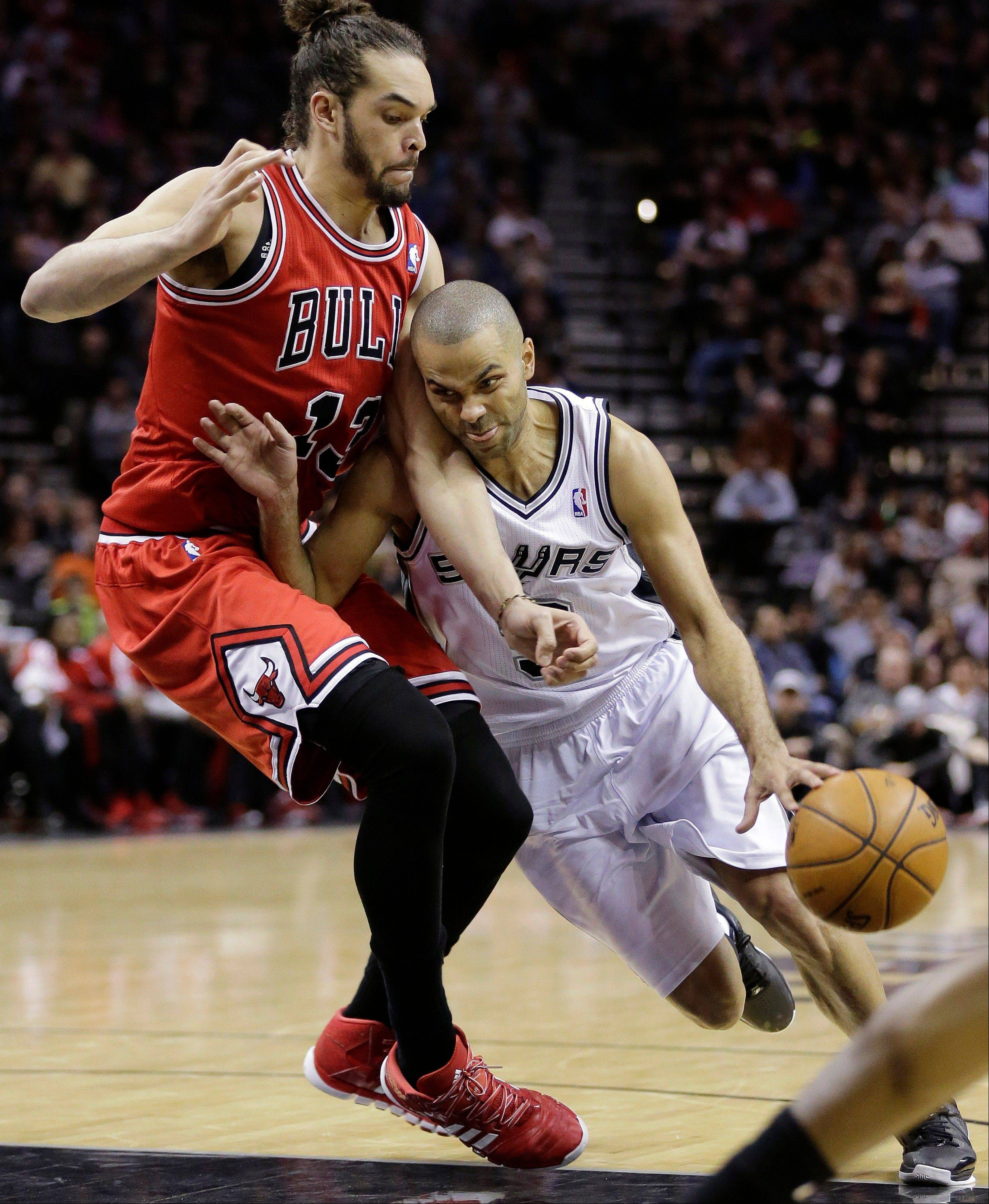 The Spurs' Tony Parker drives around the Bulls' Joakim Noah during the first half of Wednesday's game in San Antonio.