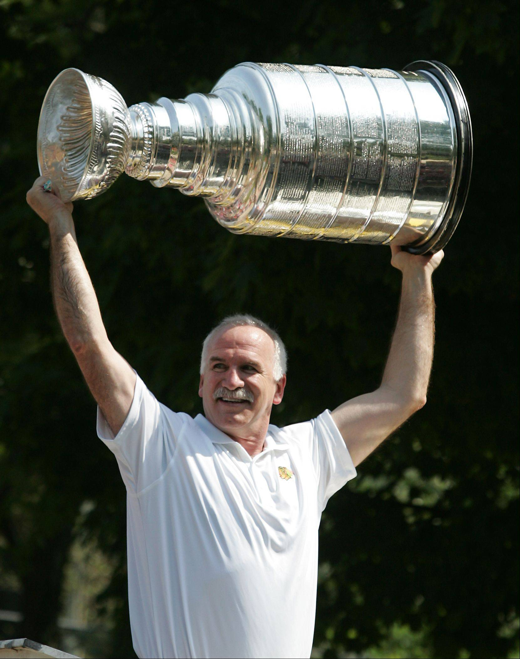 Daniel White/dwhite@dailyherald.com � Chicago Blackhawk coach Joel Quenneville celebrates a Stanley Cup victory, as the grand marshall thrills his hometown Hinsdale July 4th parade route.