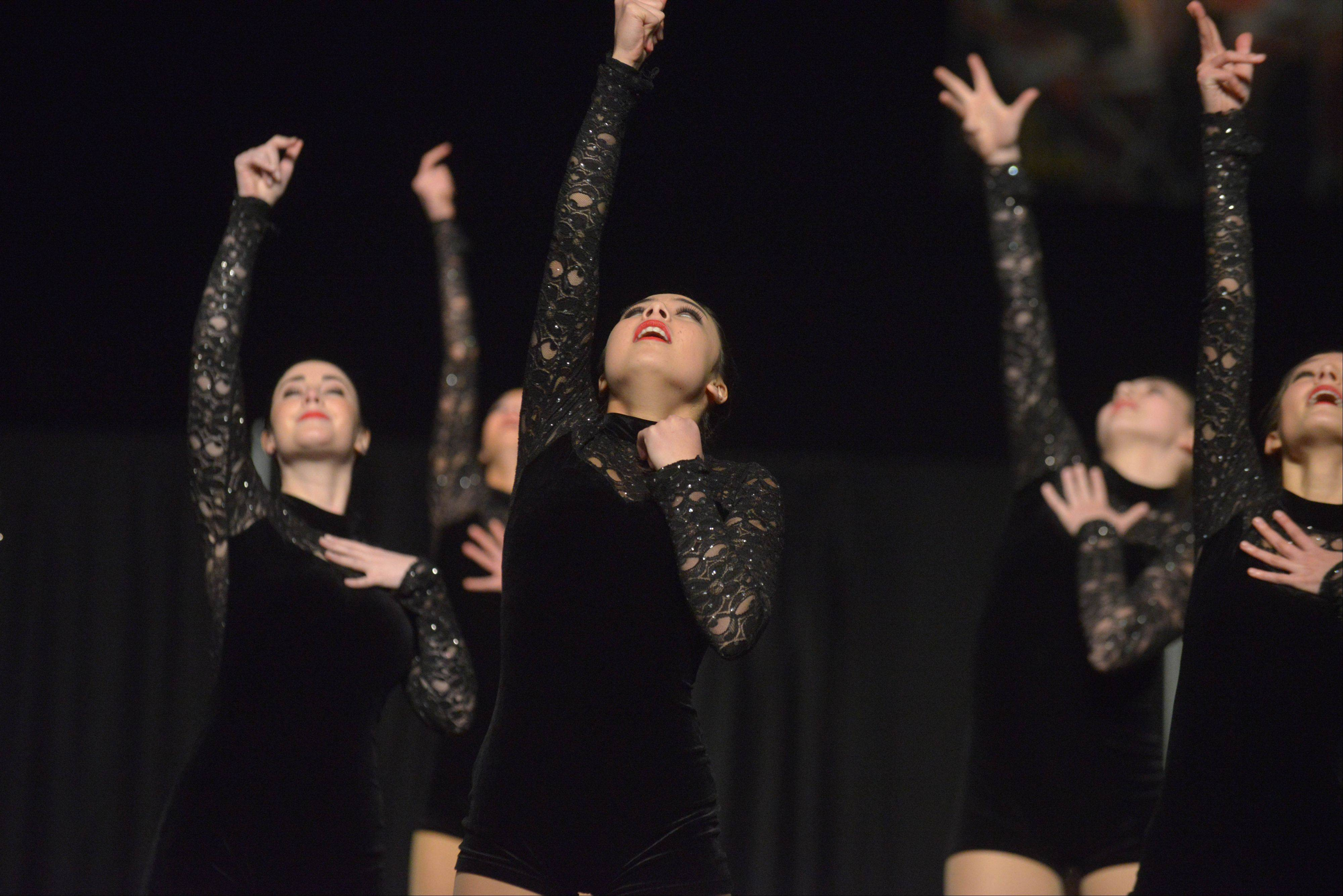 The Naperville Central High School dance team takes part in the Competitive Dance preliminary round Friday at U.S. Cellular Coliseum in Bloomington.