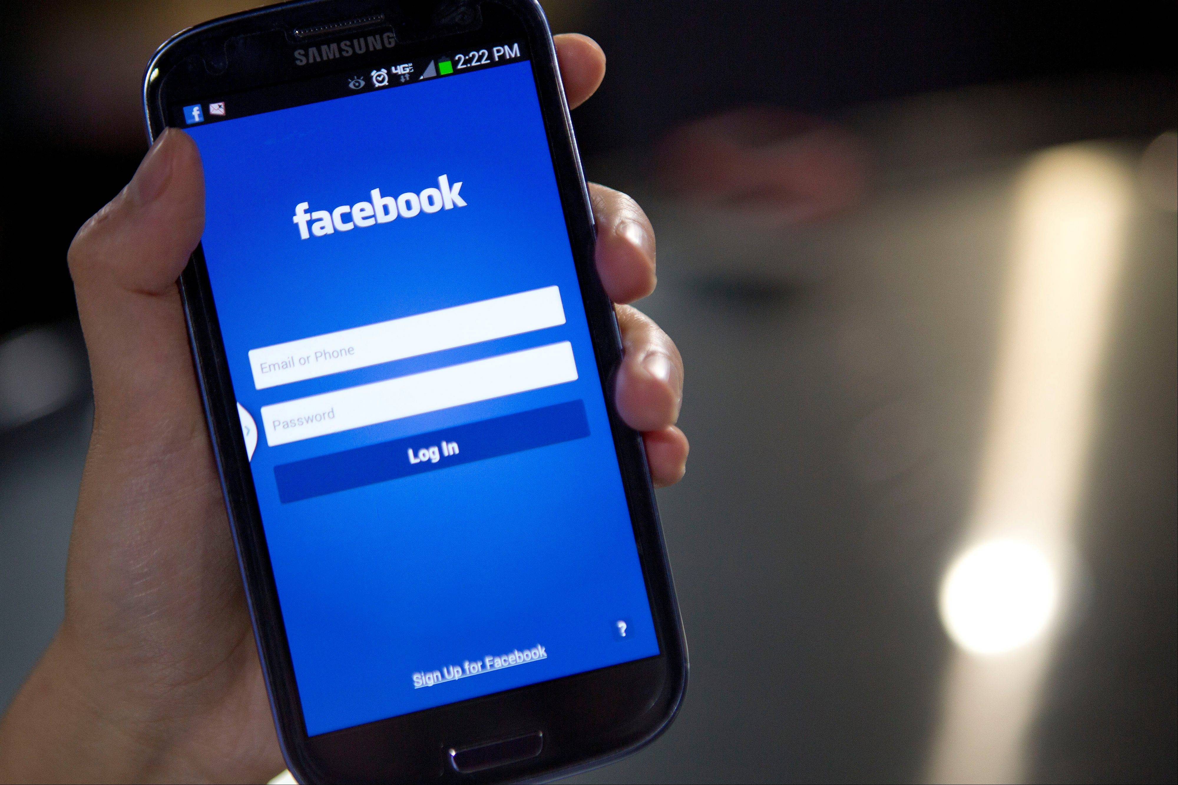 The Facebook Inc. application is displayed a Samsung Electronics Co. Galaxy S III smartphone in this arranged photograph in Washington, D.C., U.S., on Monday, Jan. 27, 2014. Facebook Inc. is expected to release earnings data on Jan. 29.