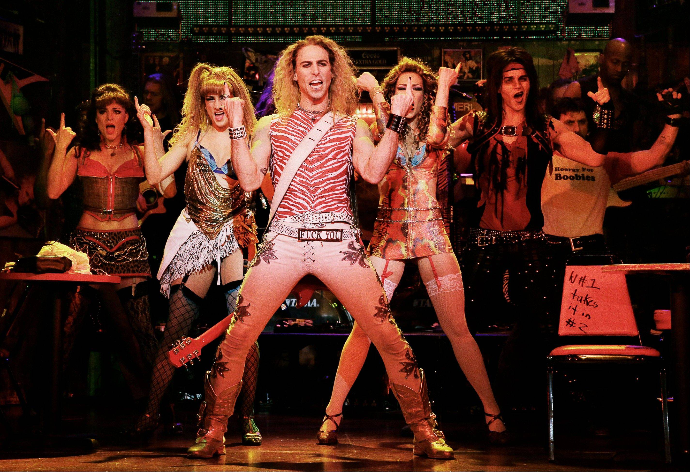 "Joey Calveri, center, plays Stacee Jaxx in ""Rock of Ages"" in New York. The cast of the Broadway show will be part of the televised pregame entertainment before Sunday's Super Bowl."